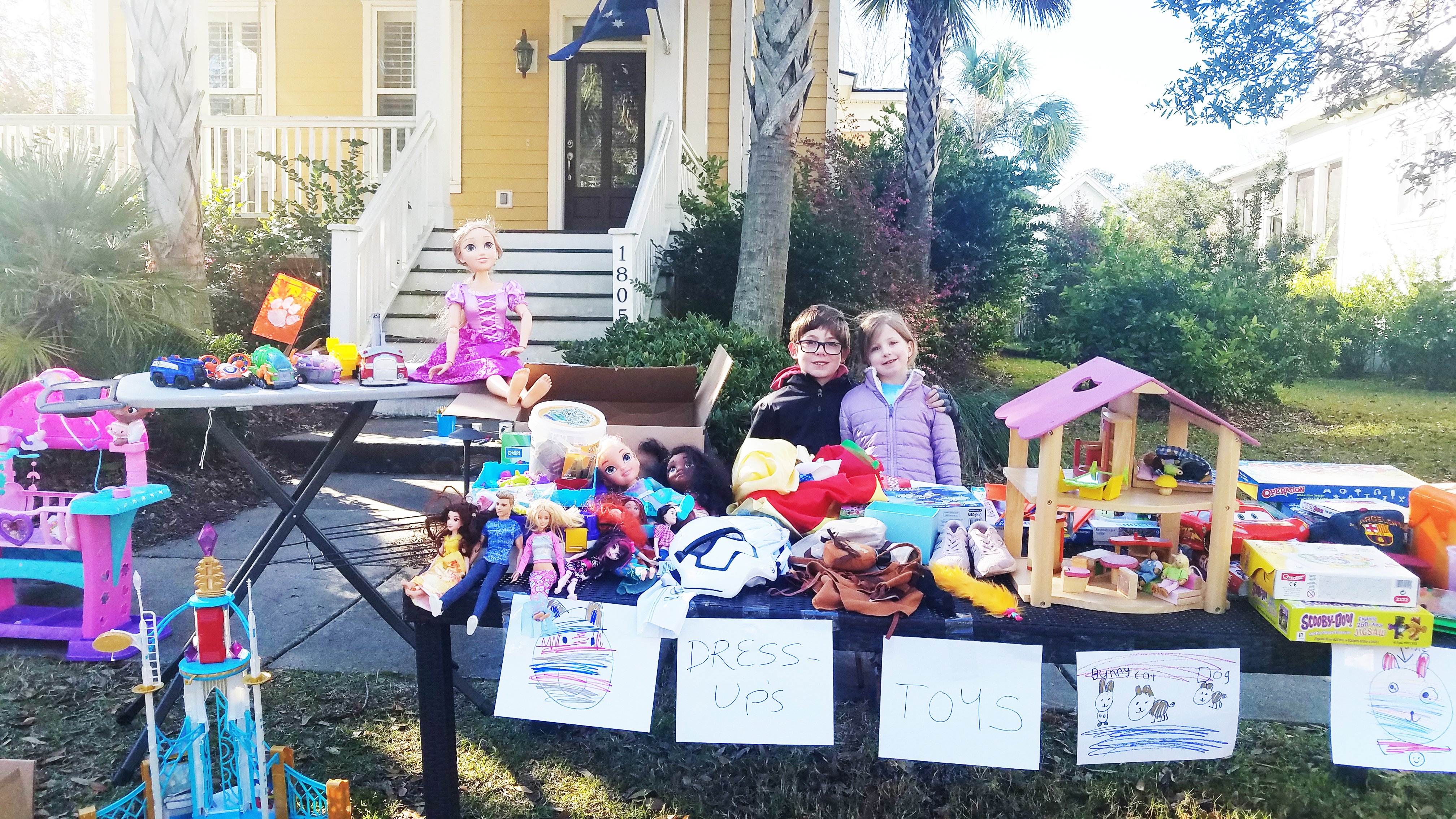 Maisie and Max Scanlon of Australia and Daniel Island were prepared to sell their old toys at the island-wide yard sale.