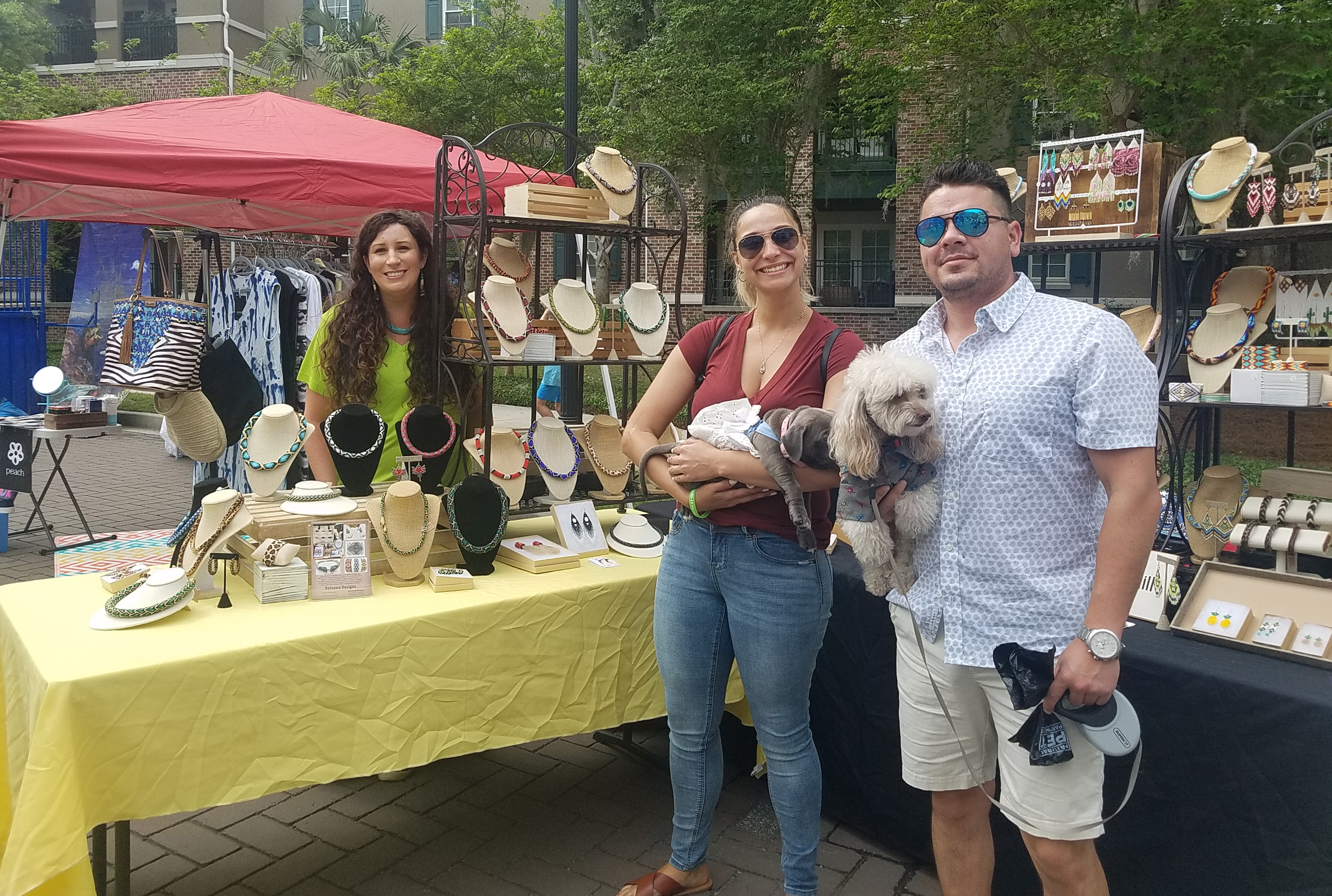 Suzanne Detar - Jessica with Dotsuwa Designs showed her wares to Debbie, holding Gorda, and to Carlos, holding Pumba.