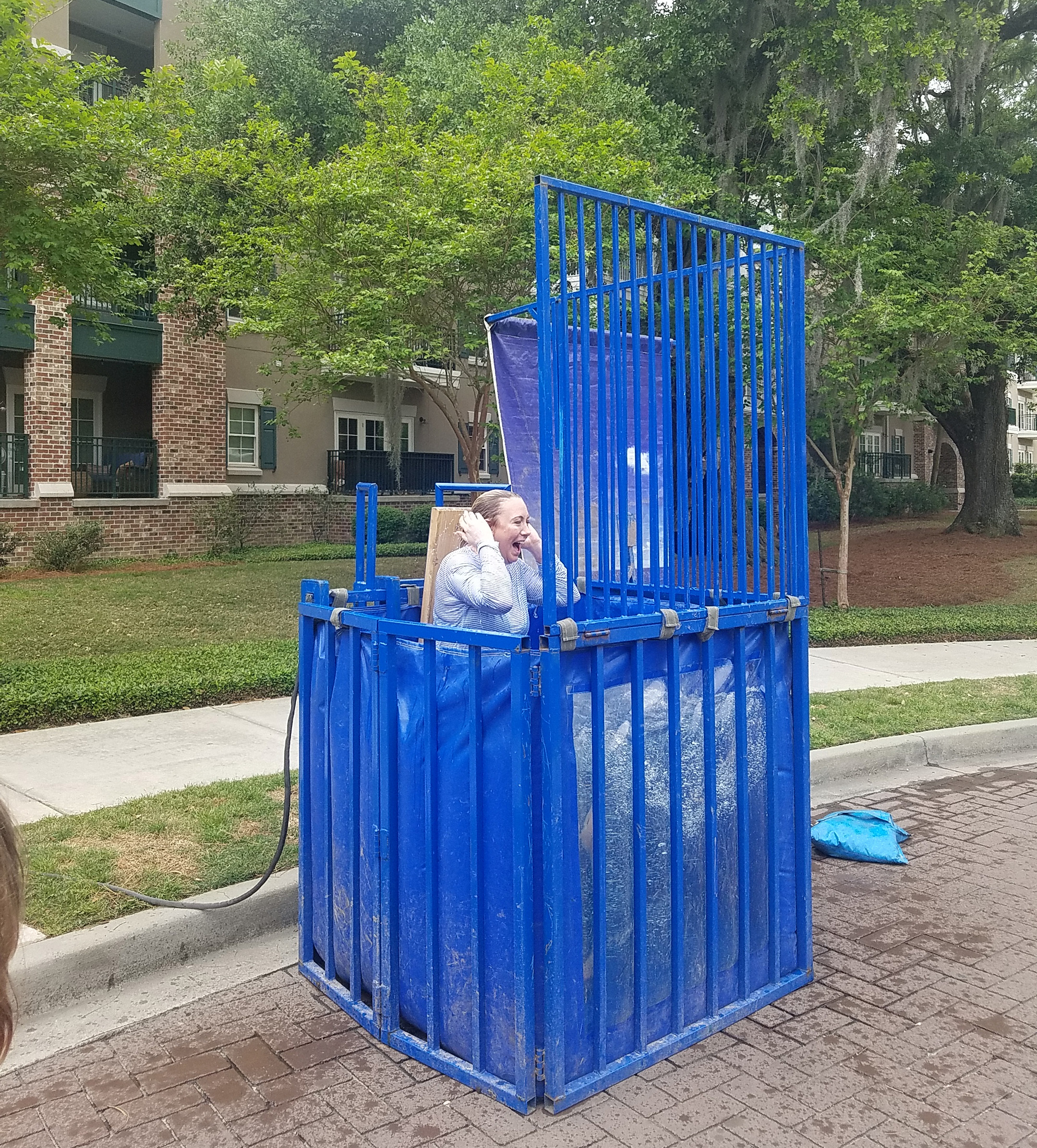 Suzanne Detar - Lindsey Miller took the plunge to support Team Rhys. Here she pops up after getting dunked by her daughter.