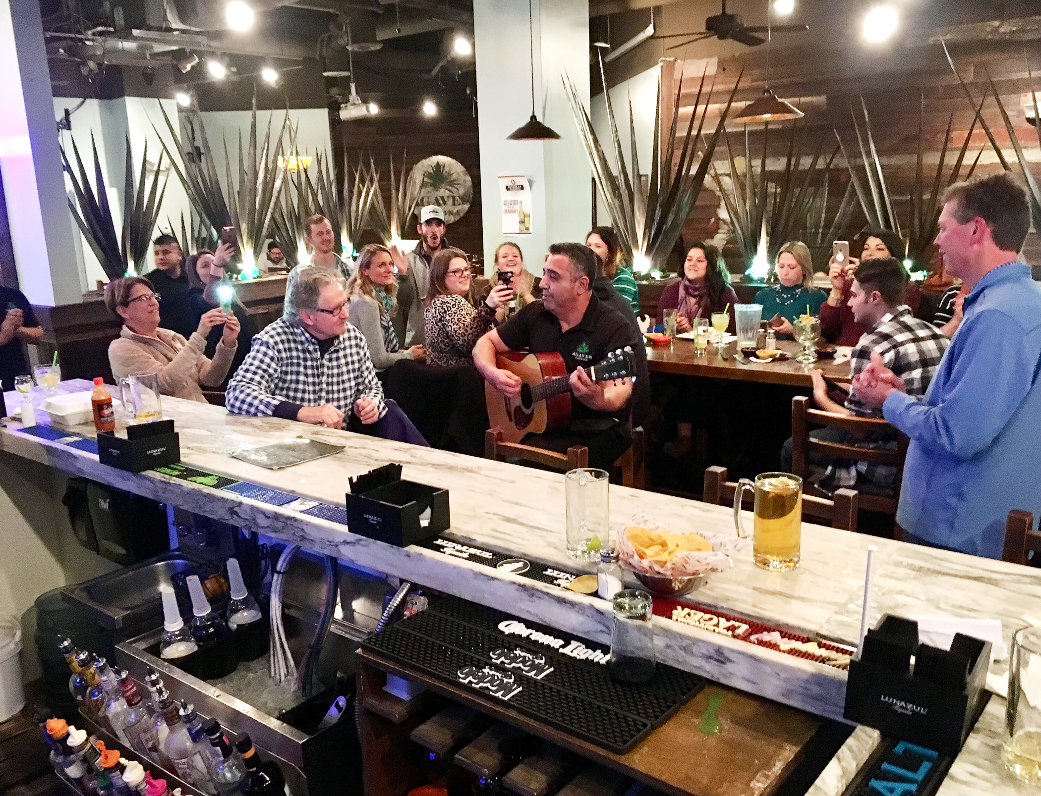 "What started out as a ""Feliz Cumpleaños"" house gesture for 15 guests at birthday gathering at Daniel Island's Agaves Cantina last month turned into full renditions of ""Feliz Navidad,"" not only sung by the entire restaurant, but led by the stunning voice of Mario Palacios, an Agaves Cantina server and bartender. Soon, kindhearted patrons who witnessed the singing began saying ""Agaves' Got Talent,"" mimicking the popular ""America's Got Talent"" tag line from the singing and dancing show on television. ""When this fellow started singing, we were all mesmerized!"" said island resident Baron Christopher Hanson, who was enjoying dinner at the restaurant that night and captured this photo."