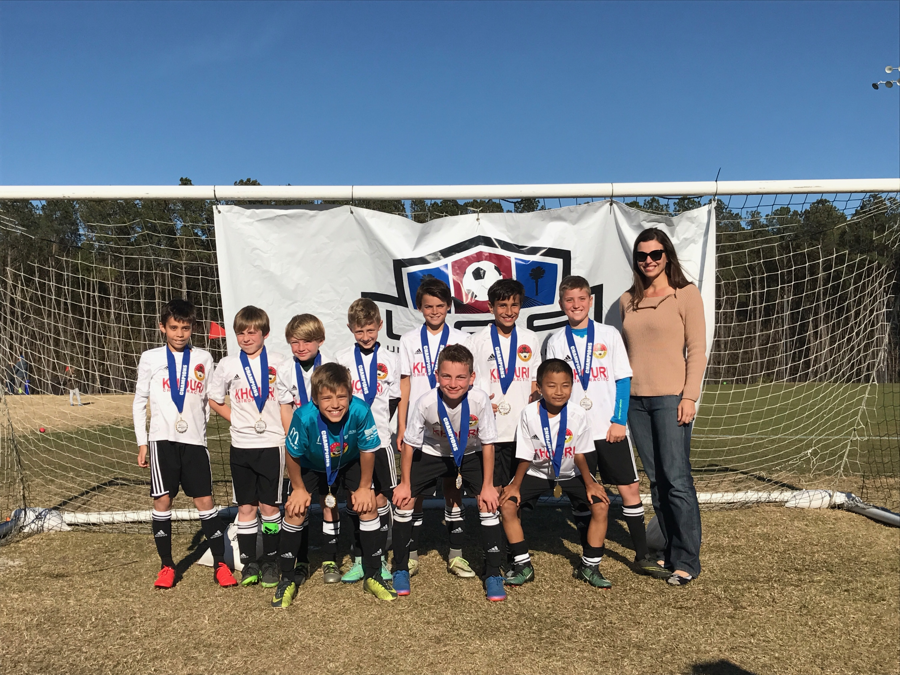 U11 Ajax (DISA) First Row: Aidan Lentsch, Jimmy Wenger, and Arkar Oo. Back row: Gabe Conlin, Chris Dubis, Levi Evans, Carter Gregory, Weston Coggeshall, Easton Khouri, Evans Baker, and Team Manager Kristi Lentsch.