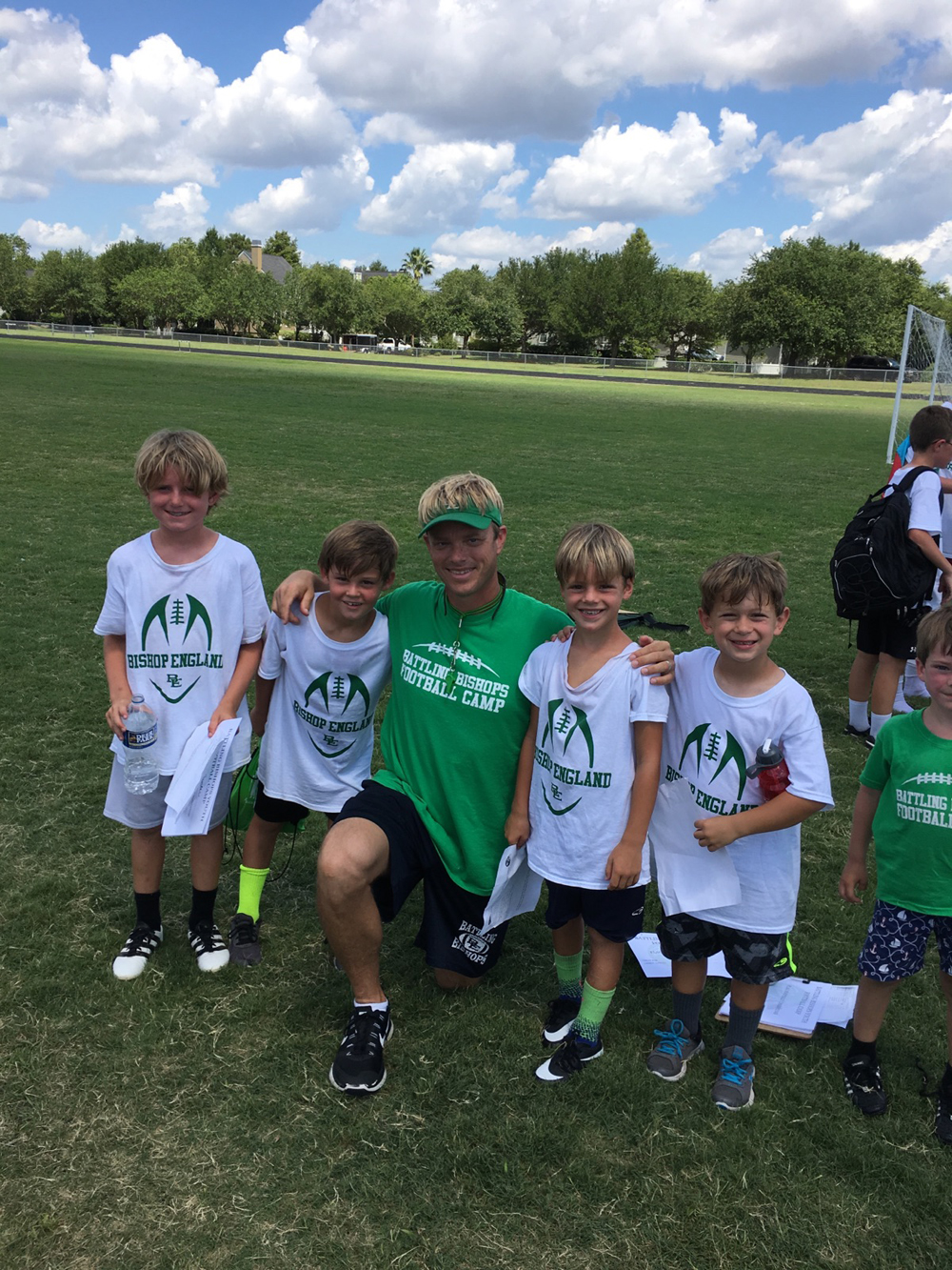 Bishop England Head Football Coach John Cantey (center) poses with Finn Gunter, Will Heffernan, Sawyer Gunter and Charlie Priester. The boys participated in the football camp led by Cantey and BE players this summer.