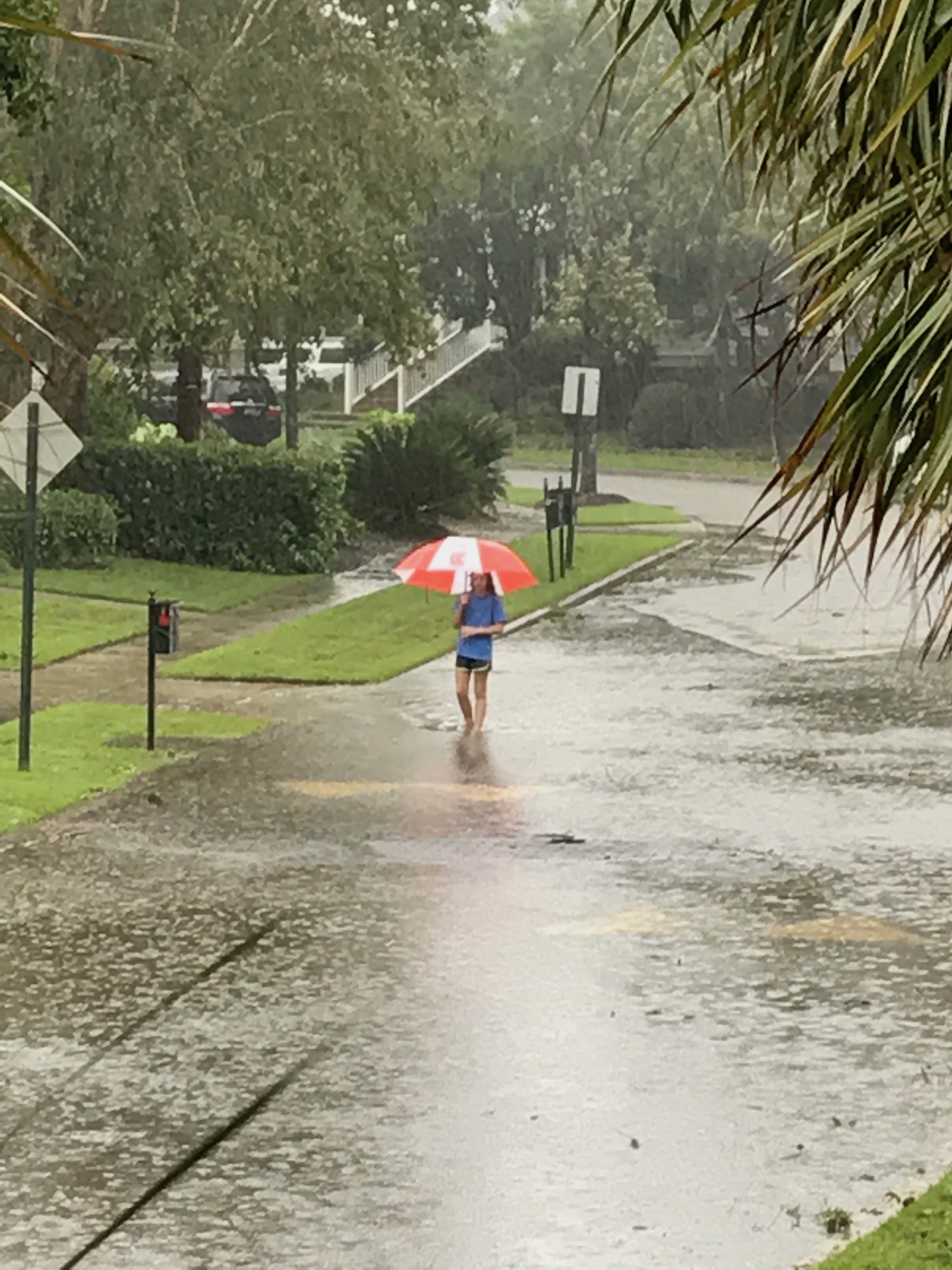 A young resident walks along Barfield Street during the storm.