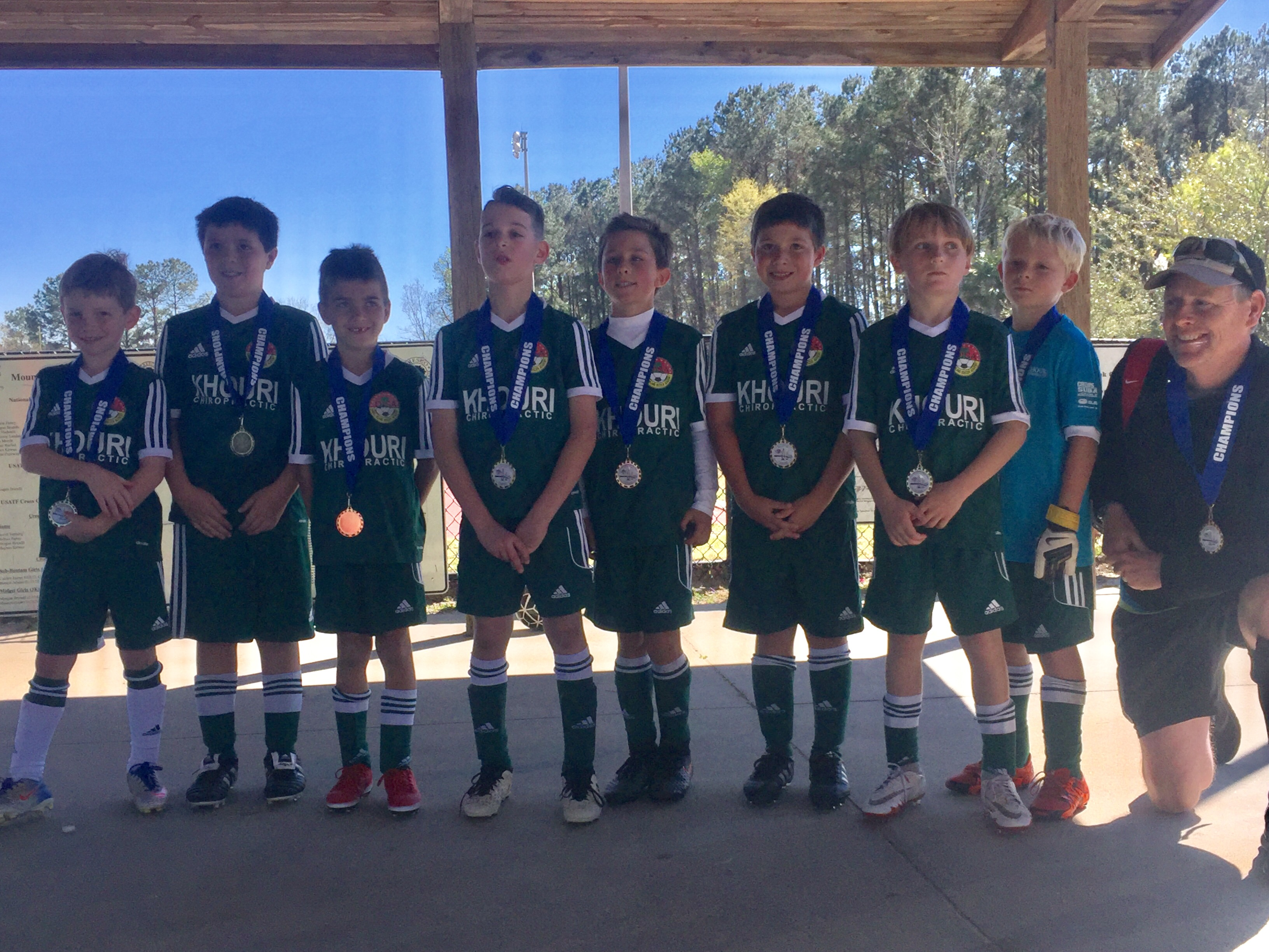 U9 Chelsea (DISA) Left to right: LJ Leveen, Hugh Mathews, Nate White, Sam Pesnik, Jackson Muller, Henley Mathews, Pierce Johnson, Logan Leddy, and Coach Hal Cauthen.