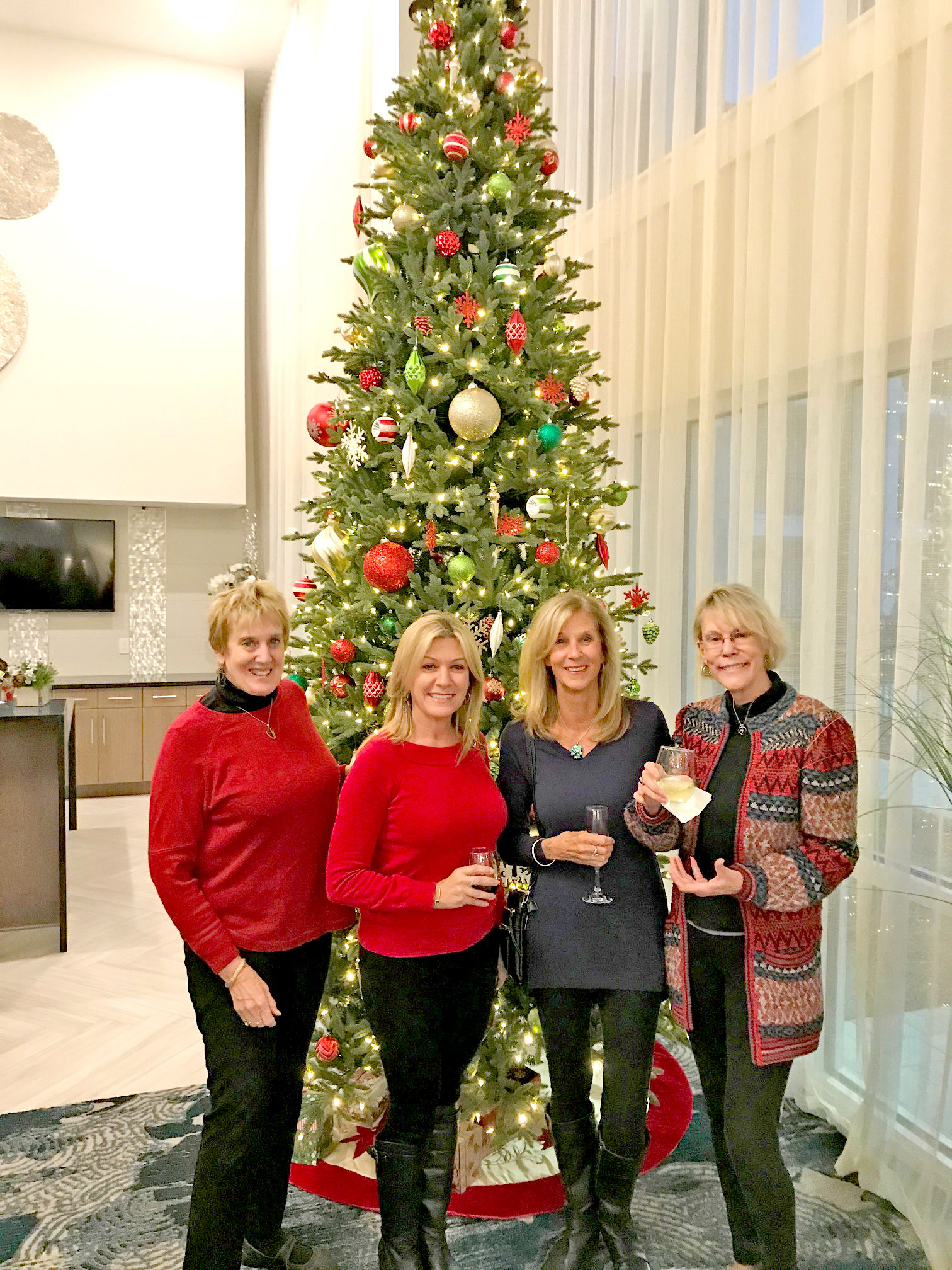 Hanging out under the gorgeously decorated tree is, from left, Vicki Rosenberg, Amy Smith, Karen Lemanske, and Katherine Chaddock.