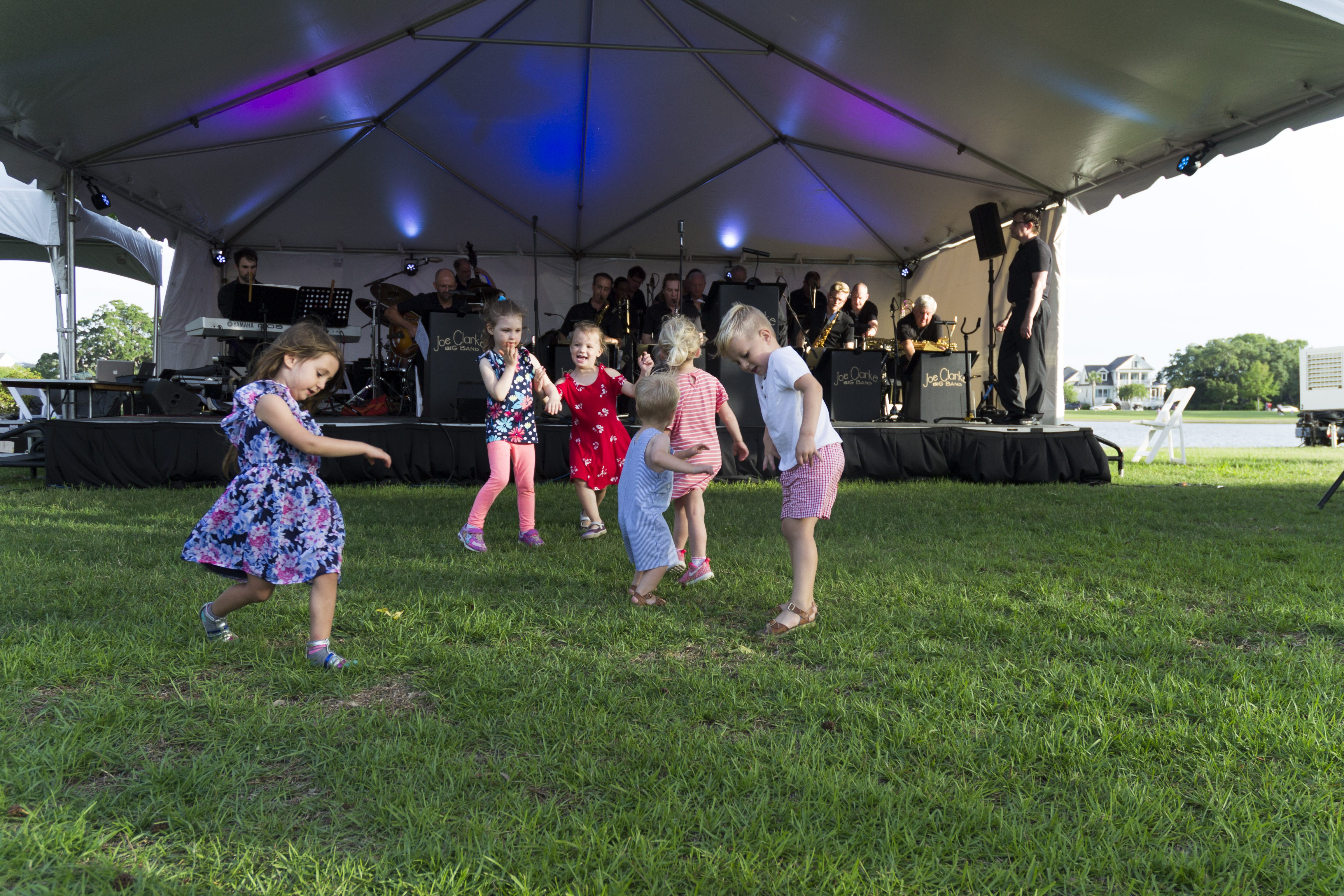 """Young attendees """"get their groove on"""" while listening to the Joe Clarke Big Band."""
