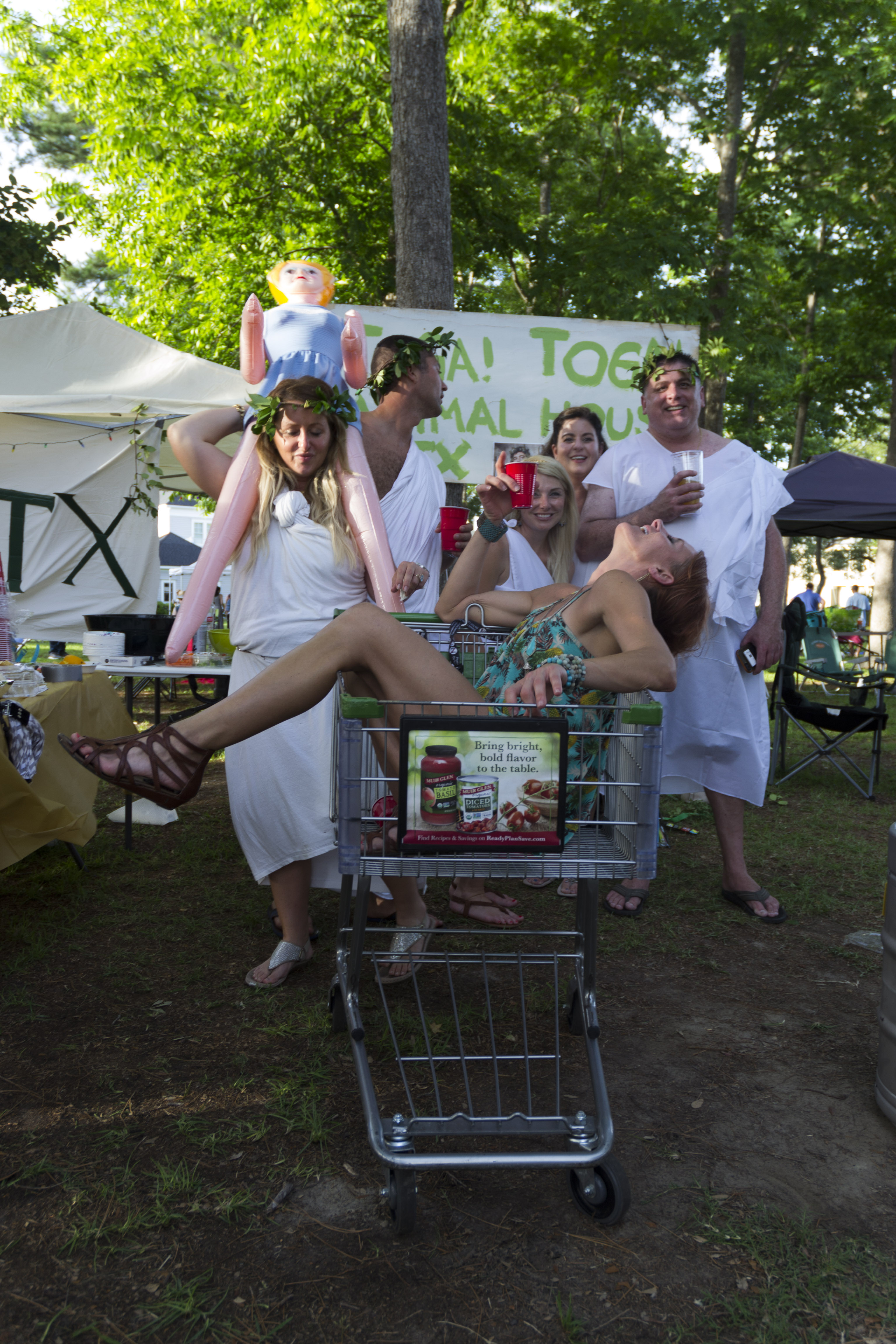 """See if you can guess who they are! """"The Toga Party"""" picnic tent paid homage to the iconic movie """"Animal House."""""""