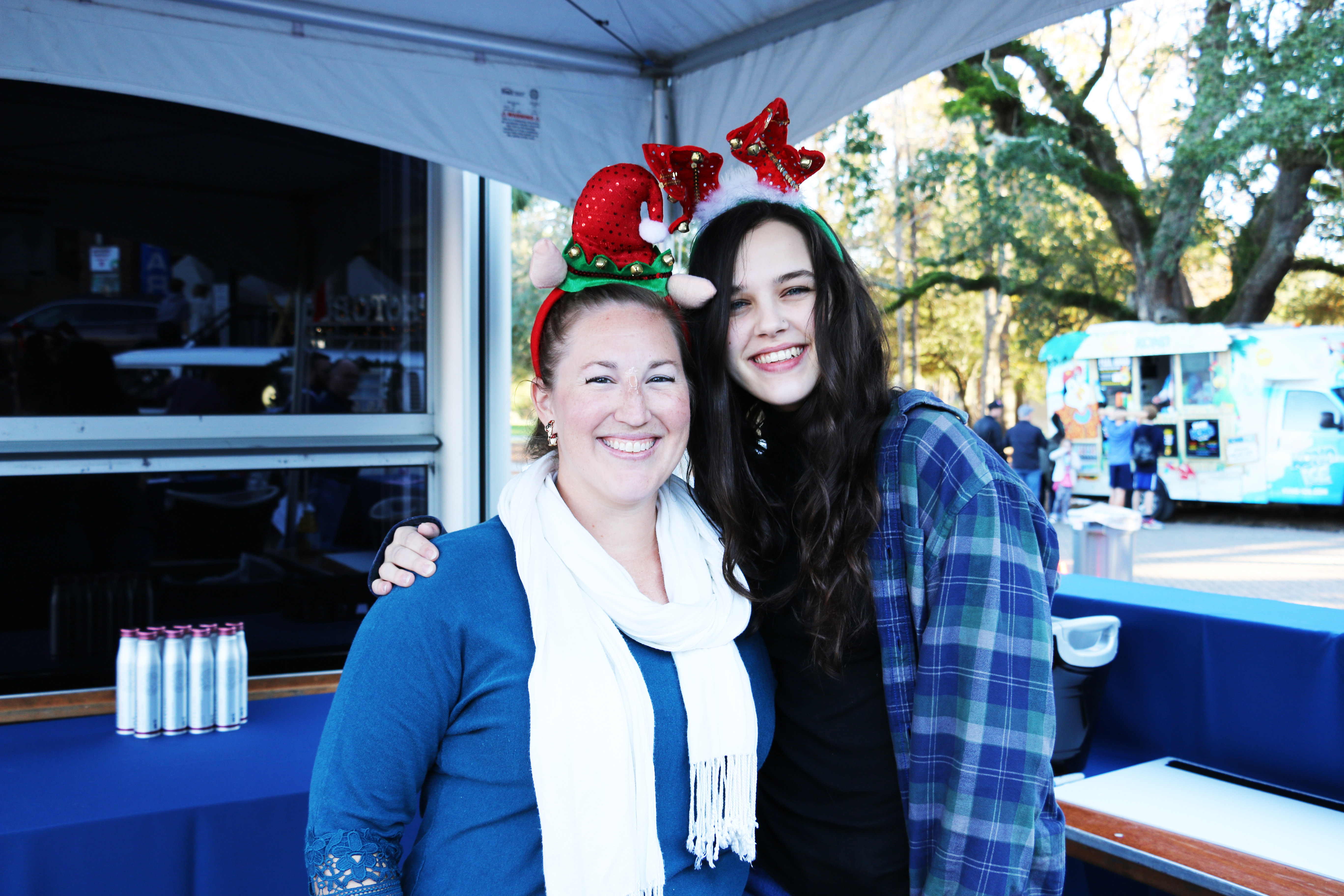 Jessica Skinner and Madeline Wood help make the festival merry and bright!