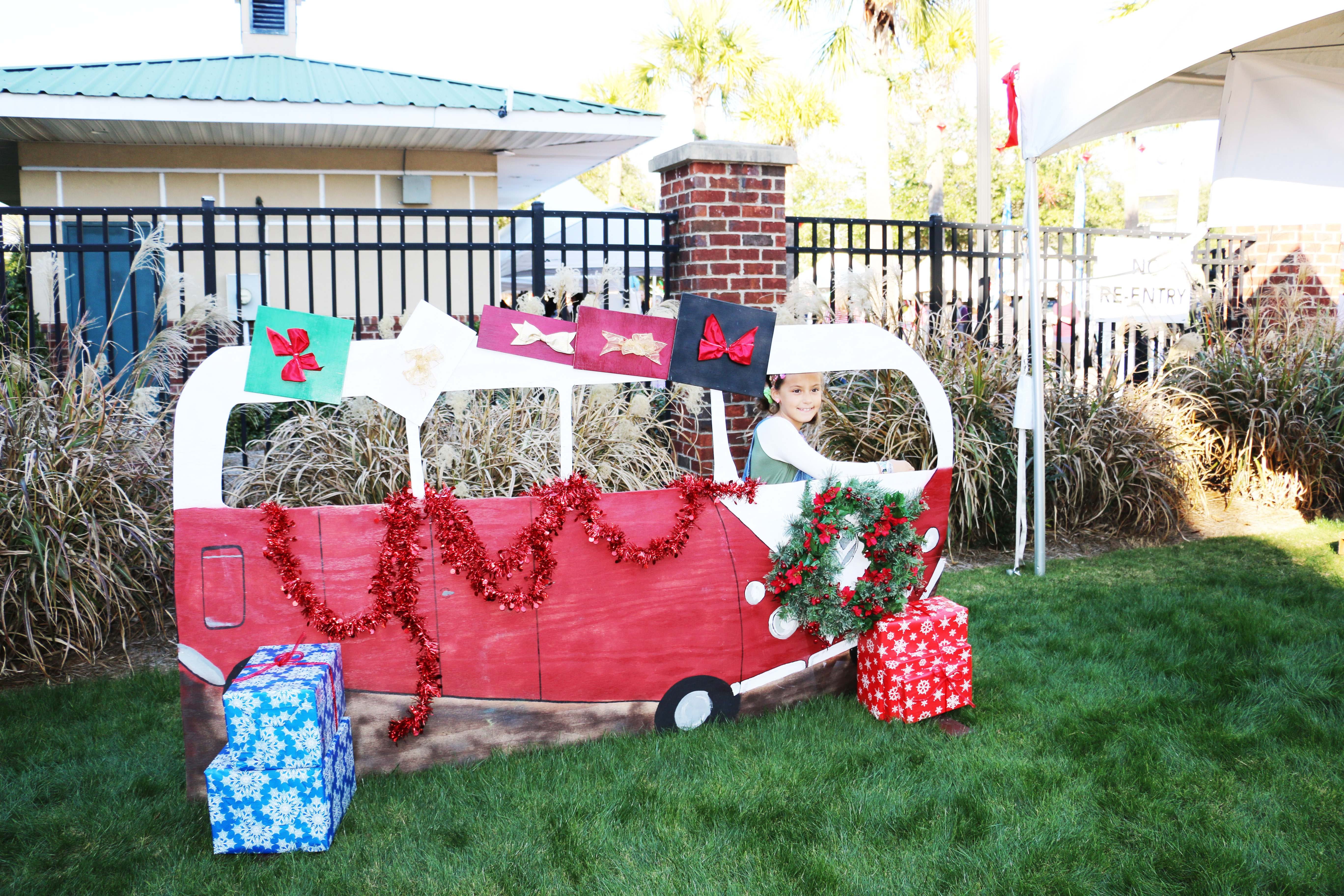 Rell, whose parents said she reads The Daniel Island News every week, poses for a picture with a holiday-inspired VW Bus.