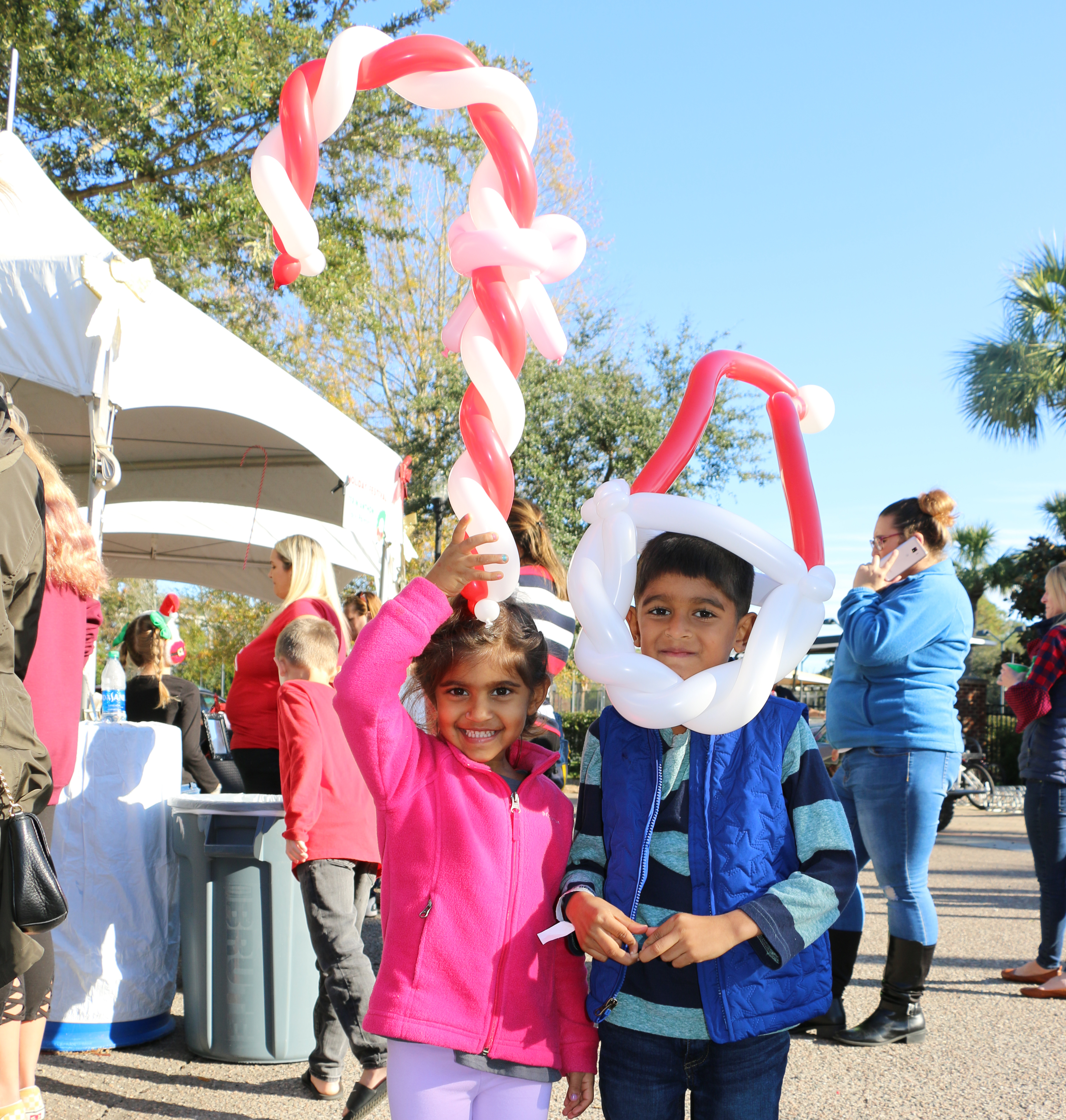 Sania and Ayan Gupta get in the holiday spirit with red and white balloons.