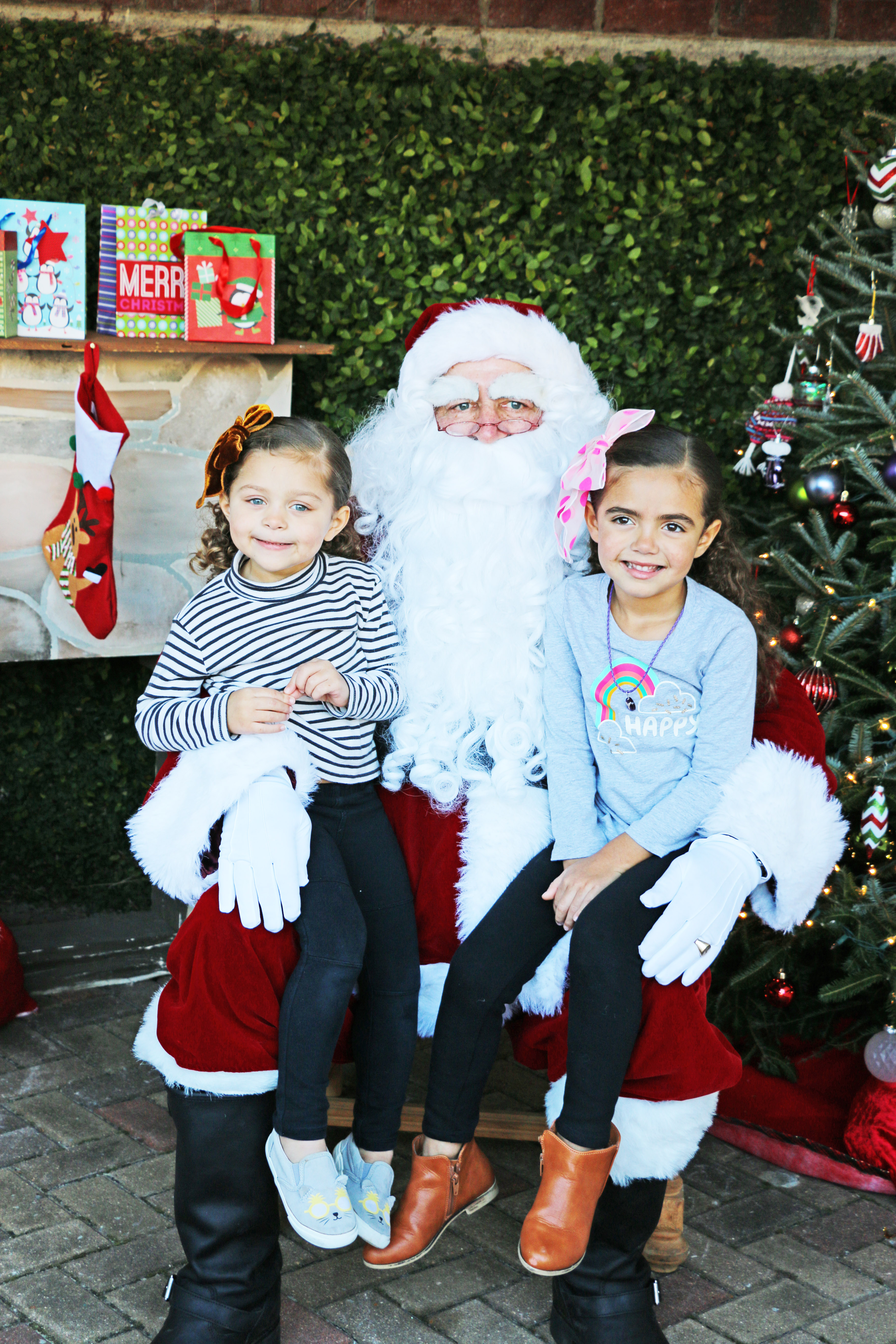 Ellis and Quincy Burke let Santa know what's on their wish list.