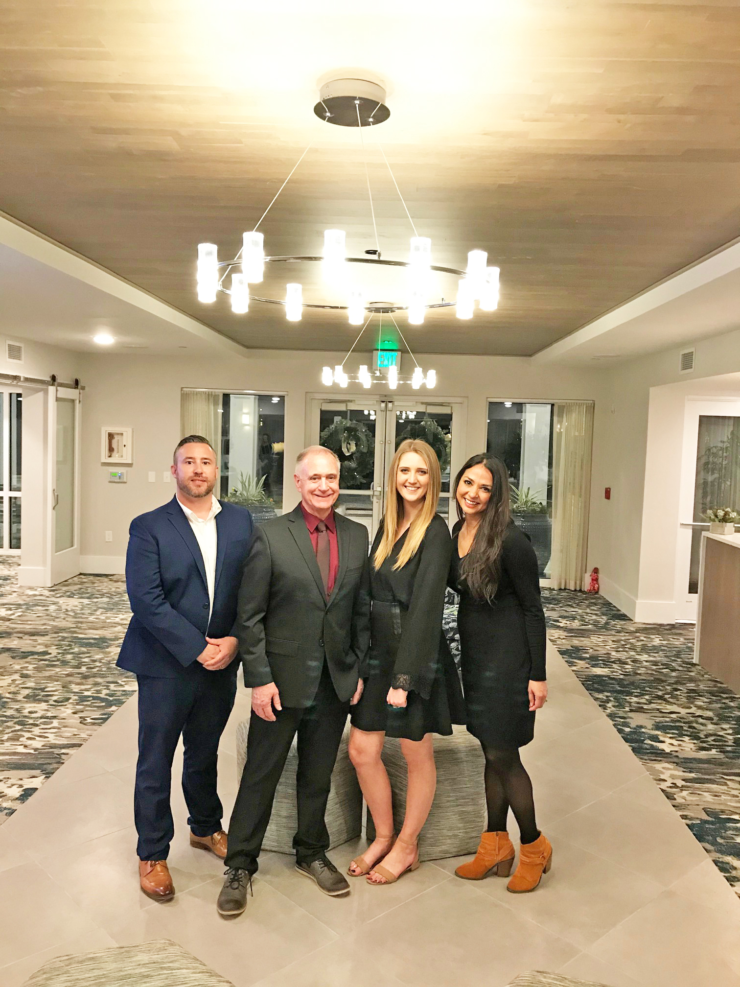 Overture Daniel Island, a new 55 and older apartment community on Daniel Island, hosted island residents and members of the business community last week as part of the Daniel Island Business Association's monthly Block Party. Pictured from left are Overture sales consultant John Ridge and manager Michael Lambrix; Riley Goldsmith, assistant manager; and Jillian Hildreth, sales consultant.