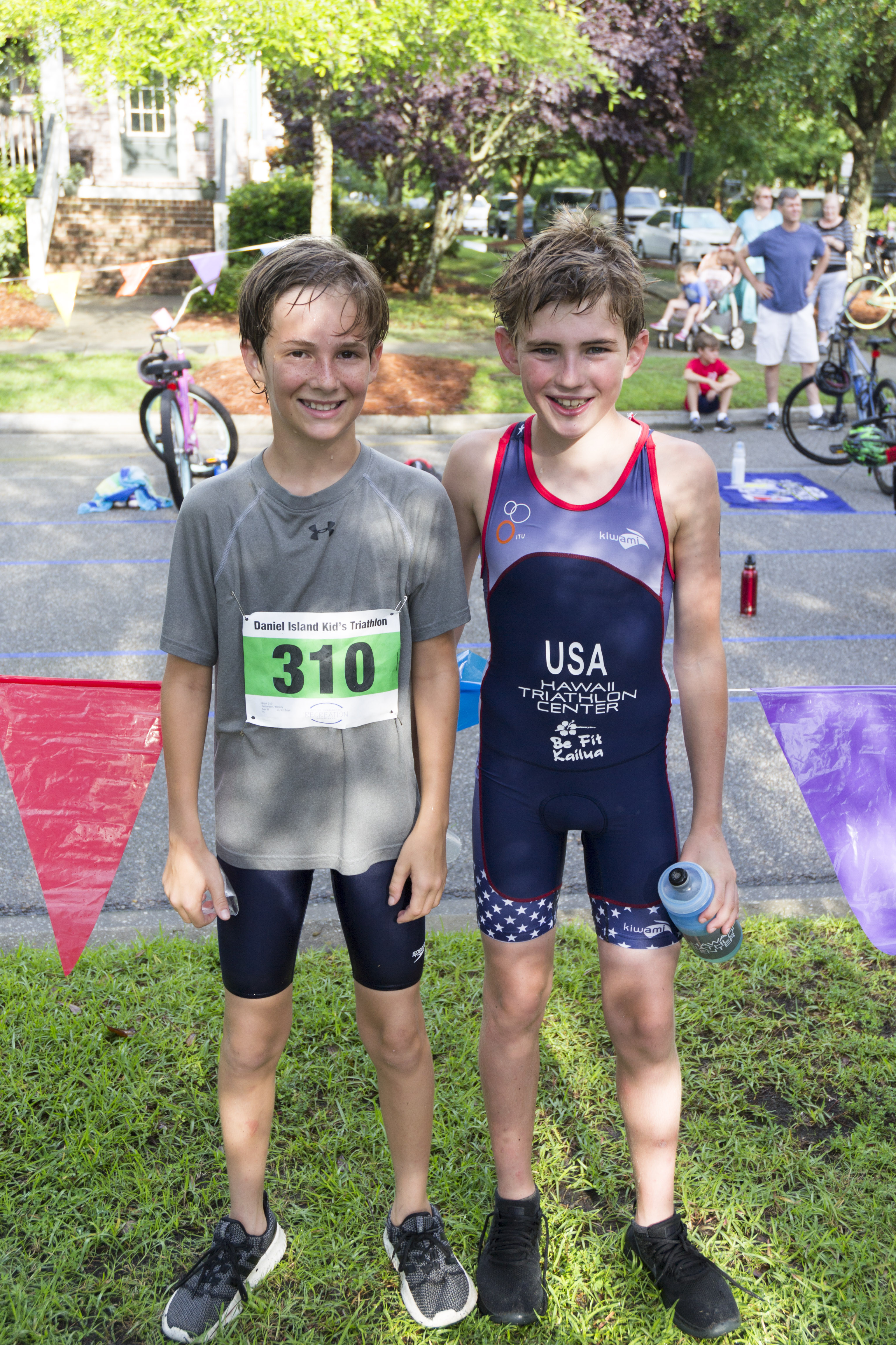 Participants Colin Harris, who placed first in the age 11-12 age group, and Wesley Patterson pose after finishing the race!