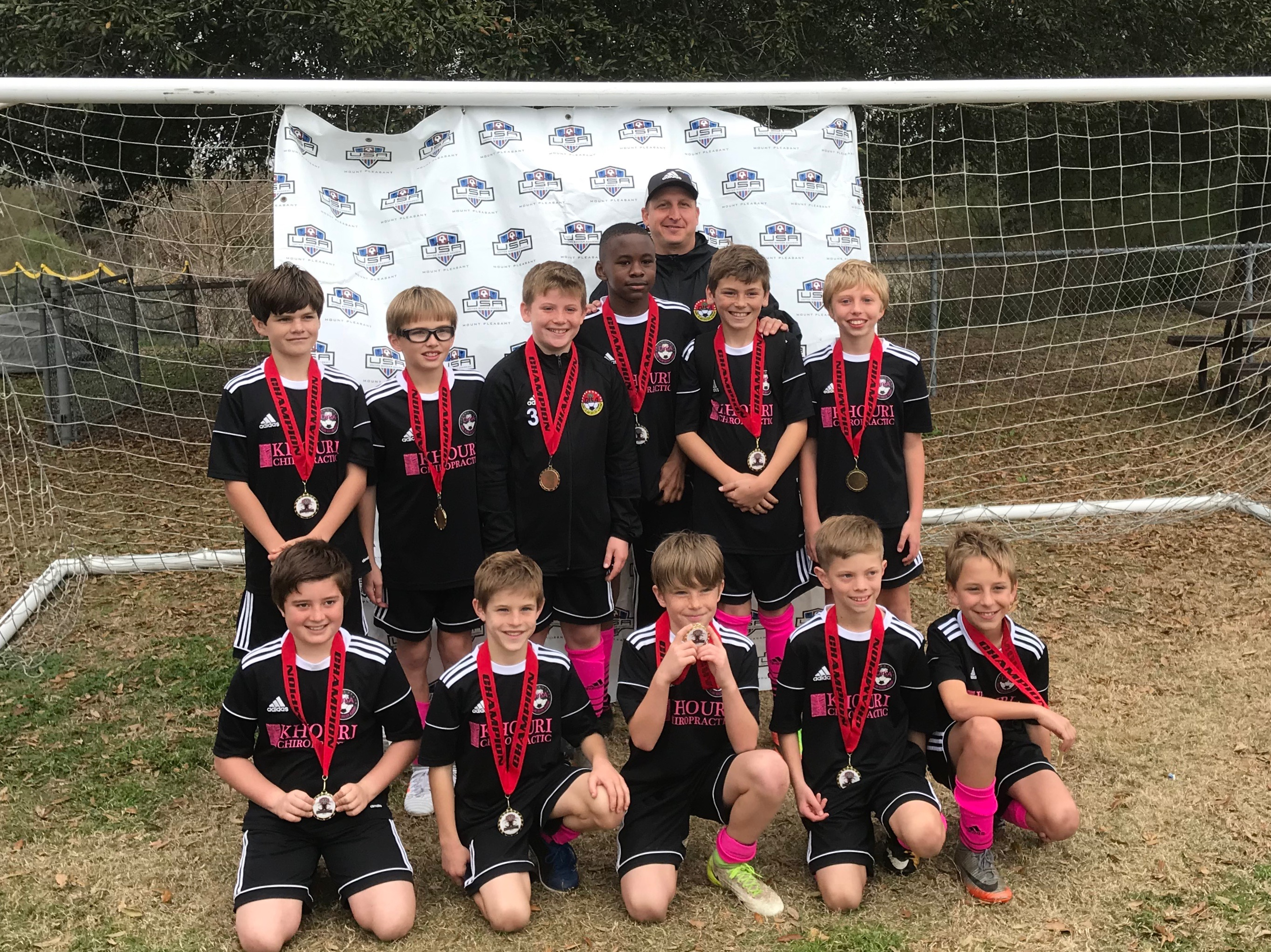 DISA's U11 Bayern! Top row (L to R): Harrison Grimm, Milling Galloway, Daniel Scarth, Sam Duncan, Banks Butler and Matthew Esse. Bottom (L to R): Matthew Ramsey, Will Varn, Reed Swanson (guest player from Dortmund), Max Toperzer and Nicholas Kirk. Not pictured are Caleb Becvinovski and Jackson Mueller (guest player from Dortmund).