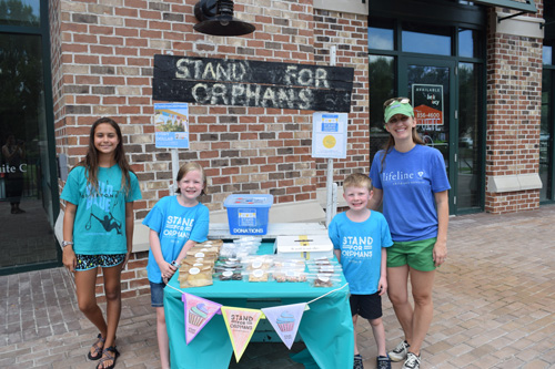 """Stand For Orphans"" was at the event selling baked goods and accepting donations."
