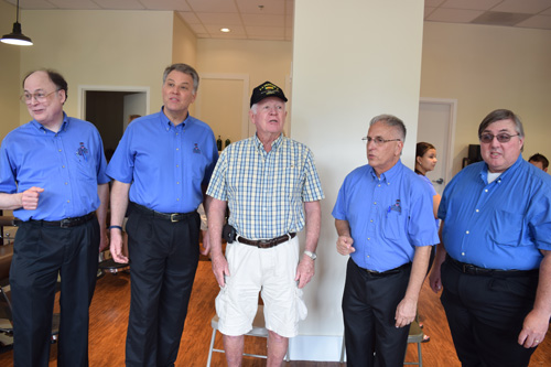 "A Daniel Island resident joins the Charleston Barbershop Chorus quartet for a ""Polecat,"" a song that all Barbershop Harmony Society members are encouraged to learn."