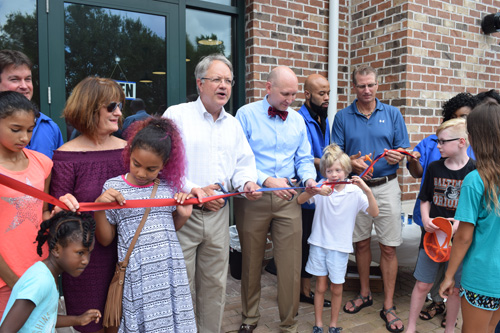 The Mayor, his wife, Sandy, owners of the Daniel Island Barber Shop and friends cut the ribbon.