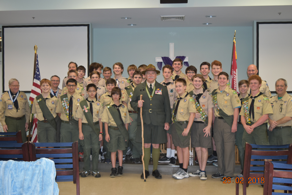"Multiple Boy Scouts in Troop 519 were honored with a plethora of merit badges (54) and rank advancements at a Court of Honor ceremony held at Holy Cross Church on Feb. 28. The group is pictured here with special guest ""Lord Robert Baden-Powell,"" who served as a guest speaker at the program."