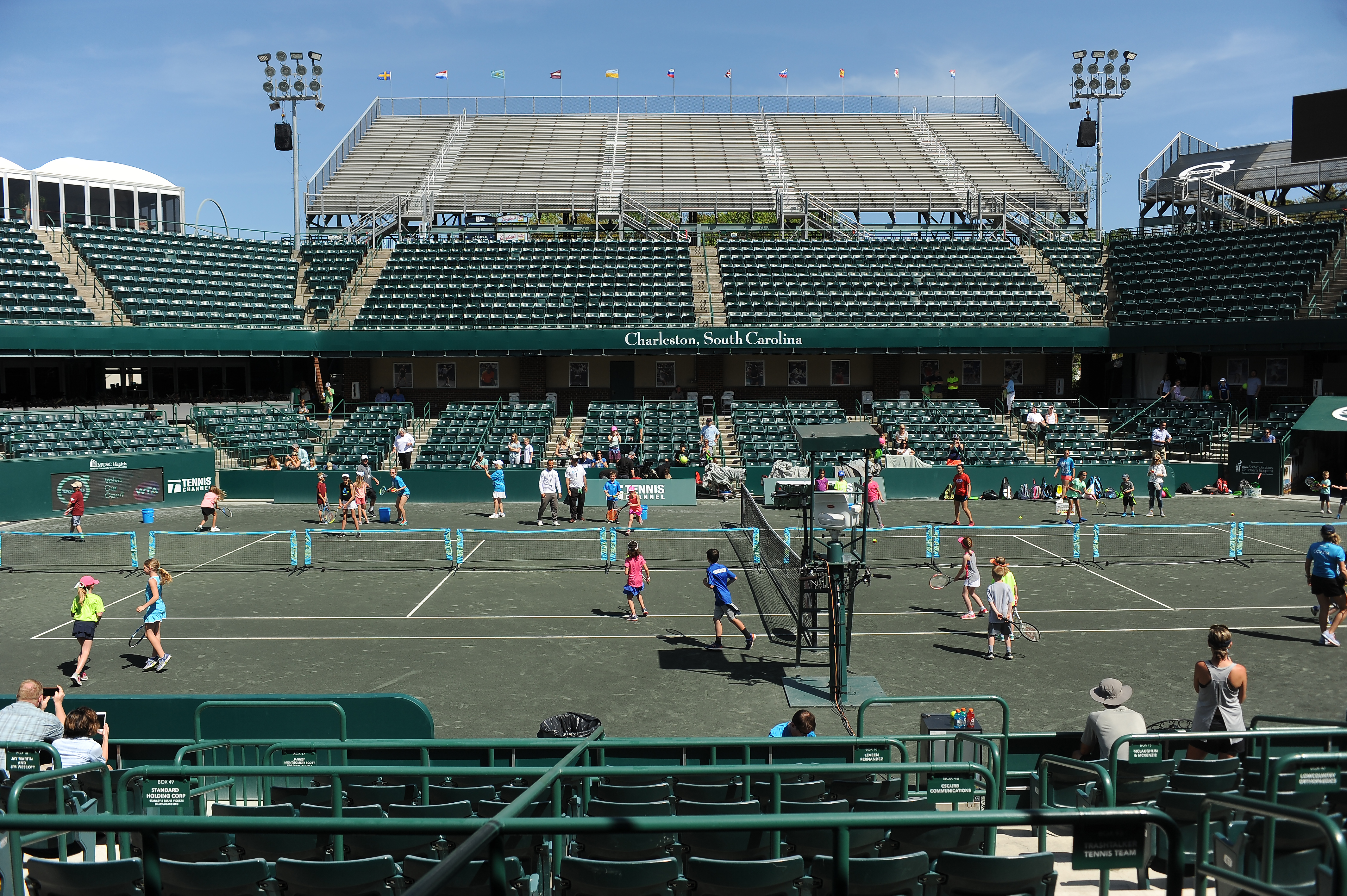 Young tennis players take a clinic on center court!