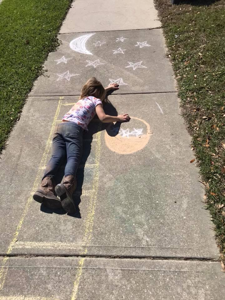 Reaching for the Stars! Ella and family drew many creative sidewalk art pieces.