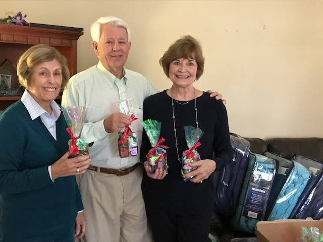 PROVIDED The Daniel Island Rotary Club provided comforters and gift bags to the residents of the Florence Crittenton home in Charleston. Pictured: Rotary spouse Nancy Hall helped deliver gifts, along with Rotarians Jerry and Billie Bacon.
