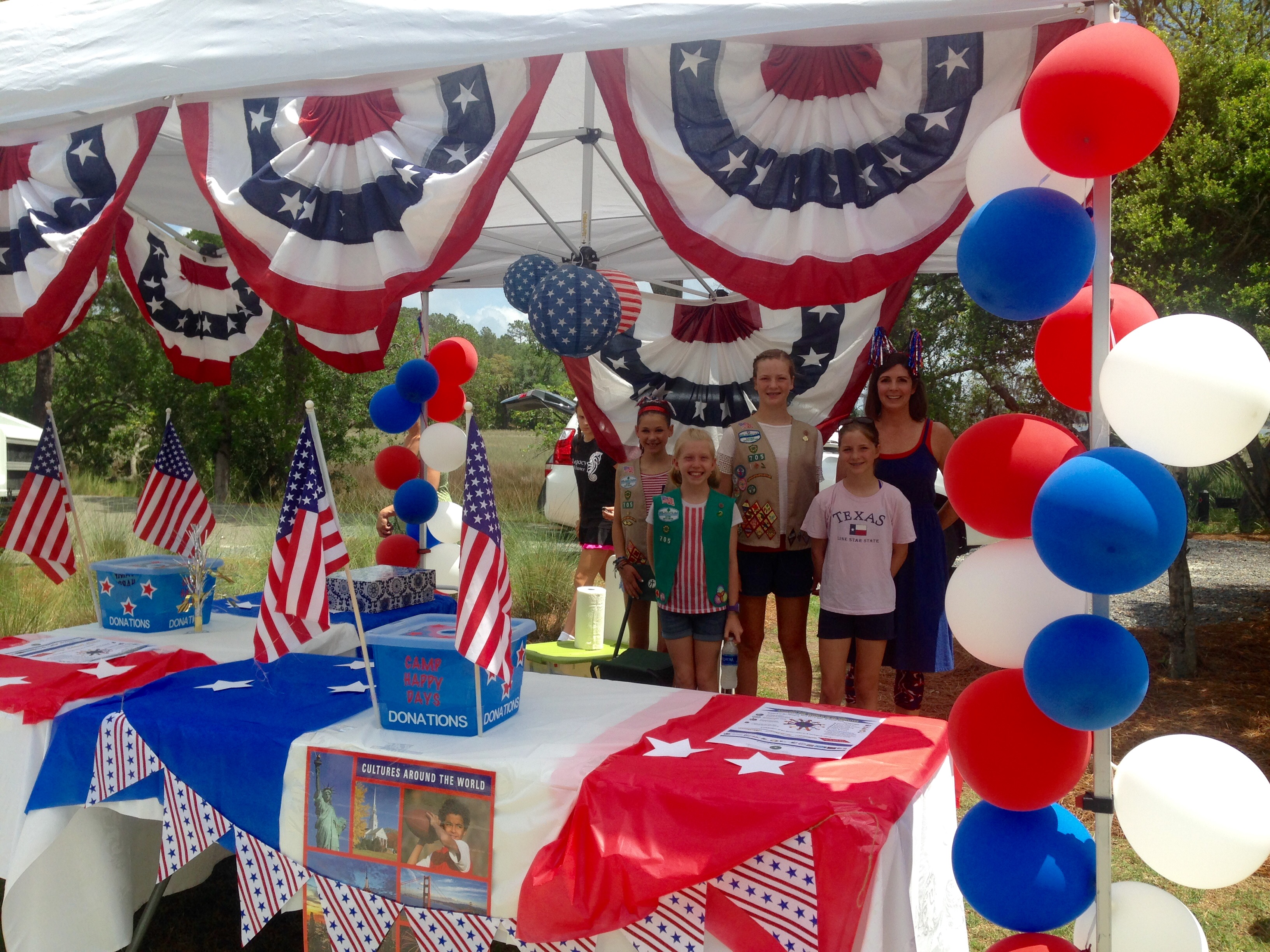 "Participants received ""passports"" at the USA Greeting tent hosted by DI Girl Scout Troop 705."