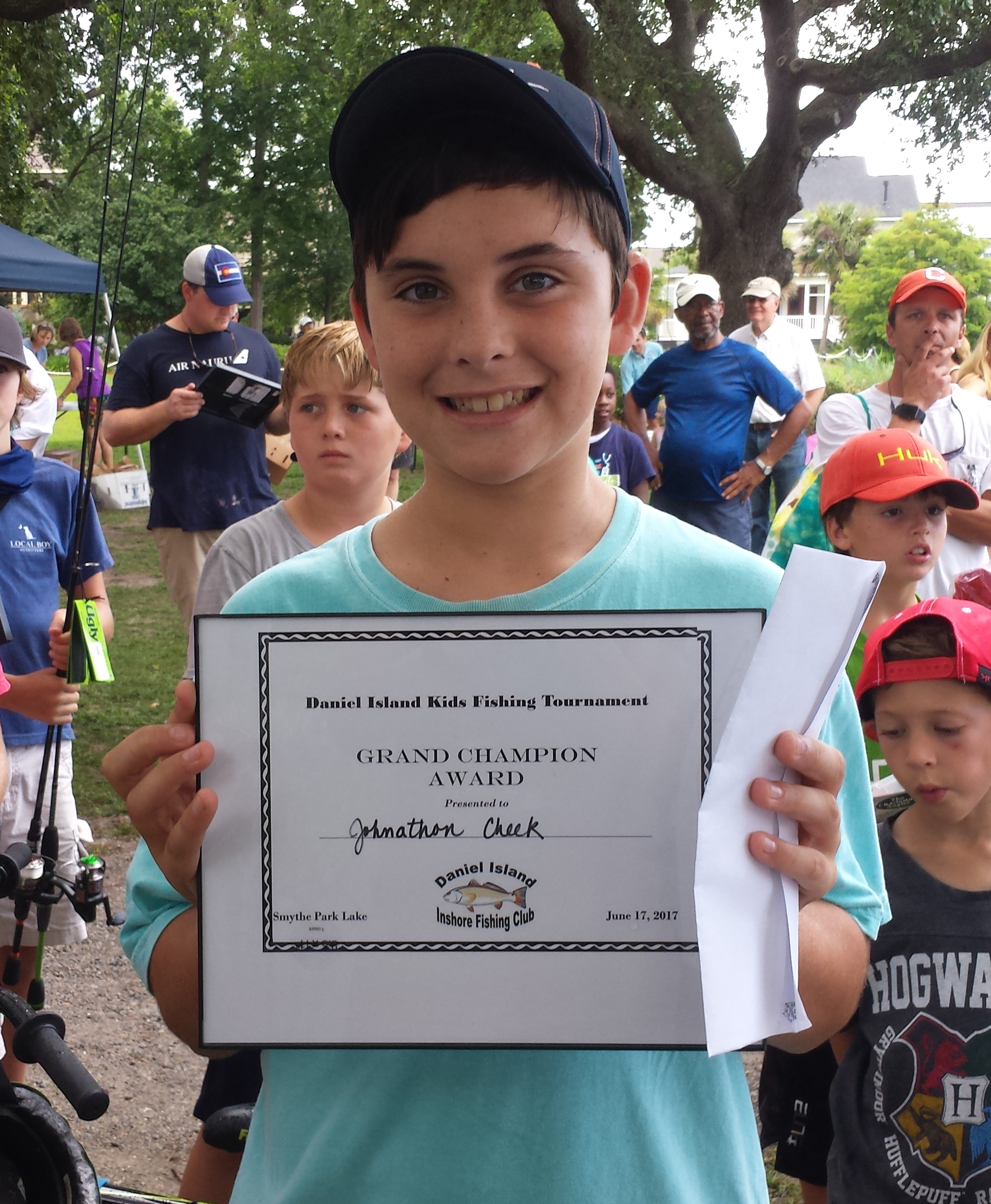 The Grand Champion of the 7th Annual Kids' Fishing Tournament was Jonathon Cheek. He caught the longest fish in the three species categories of Largemouth Bass, Panfish and Mullet by being the first to reel in a 15.5 inch bass.
