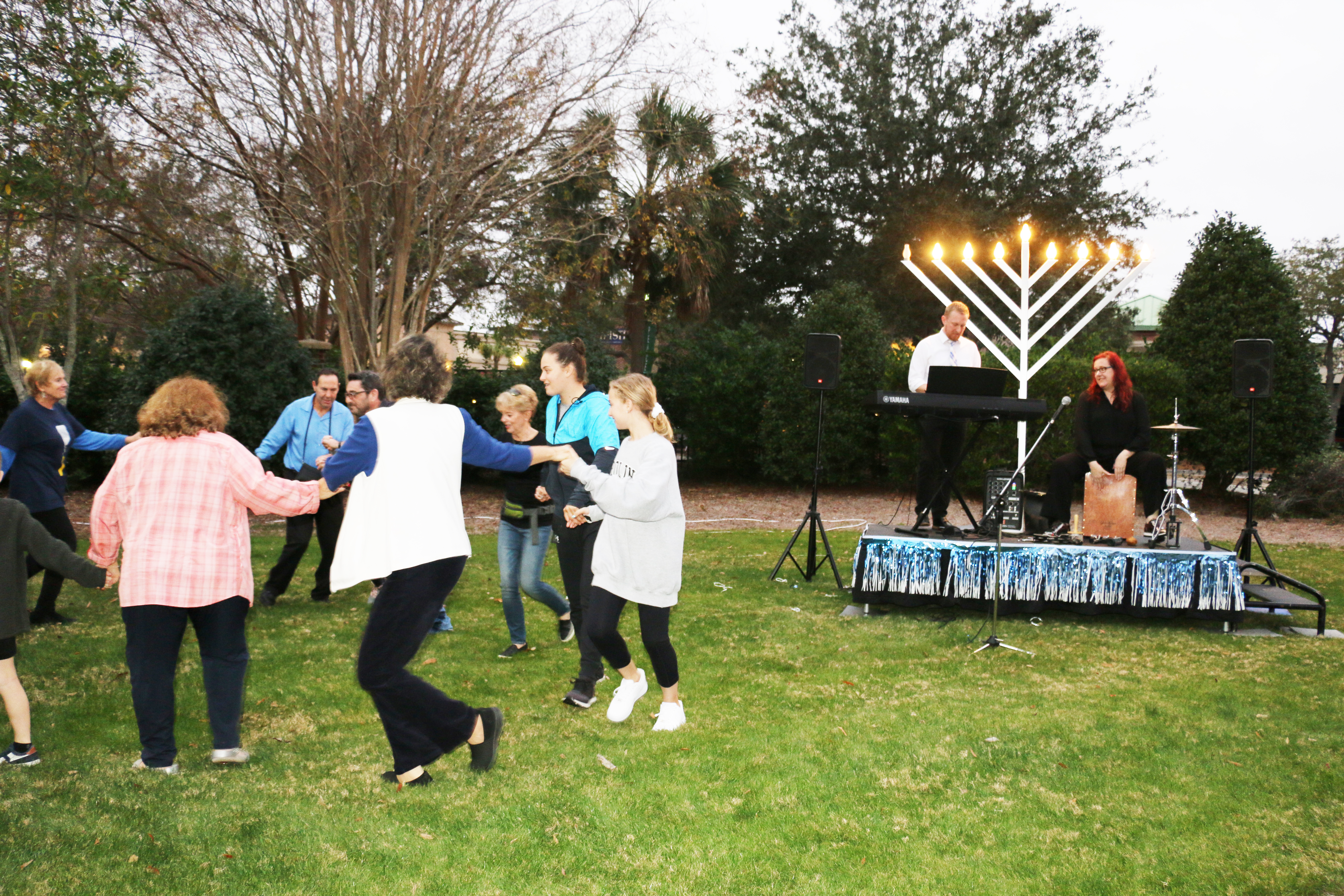 Attendees danced in celebration of miracles after the lighting of the candles on the Menorah. Black Tie owners and musicians Braeden Kershner and Kris Manning donated their musical skills for the evening.