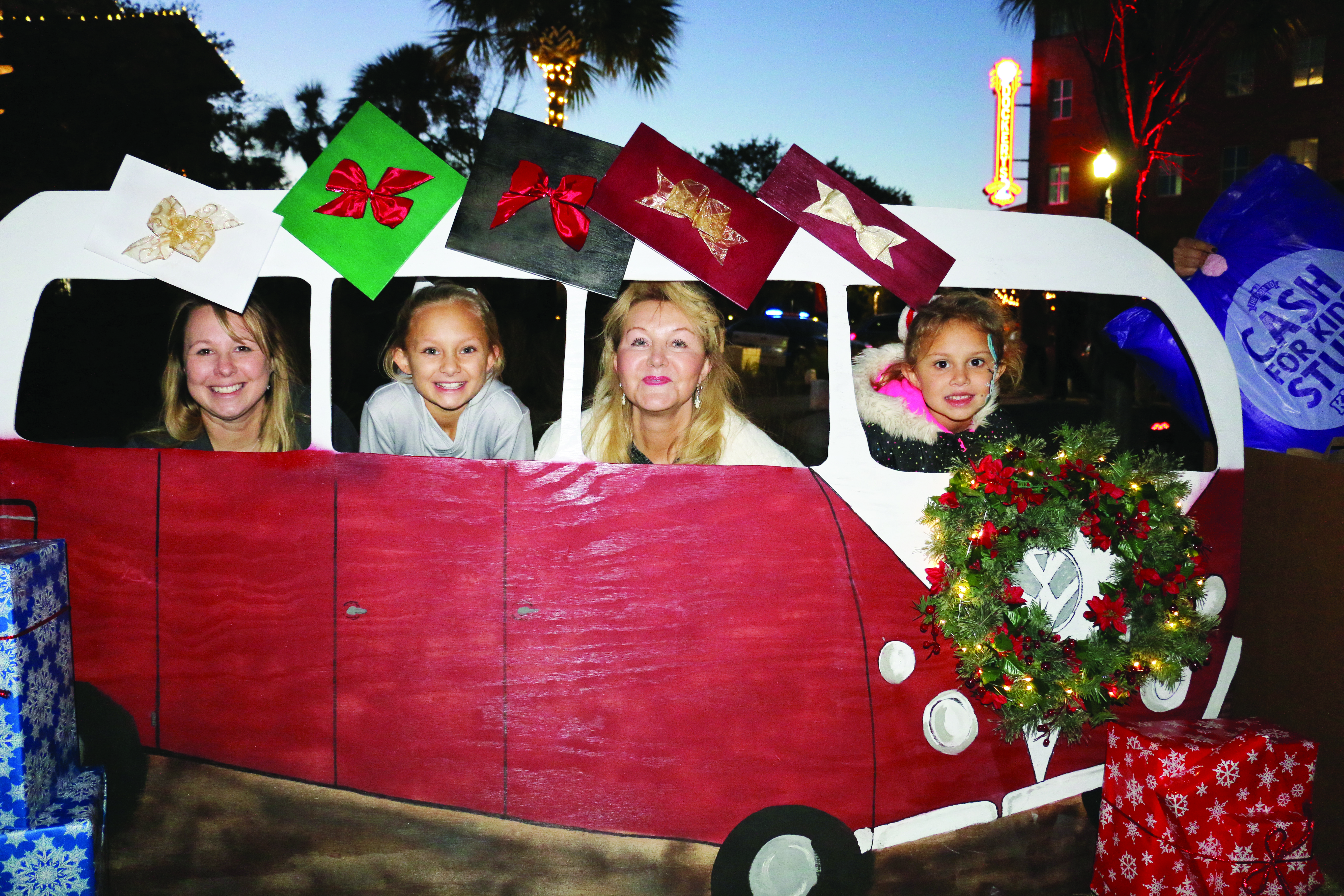Aubry, Abigail Mae, Laurie, and Leyton hop on the holiday VW Bus.