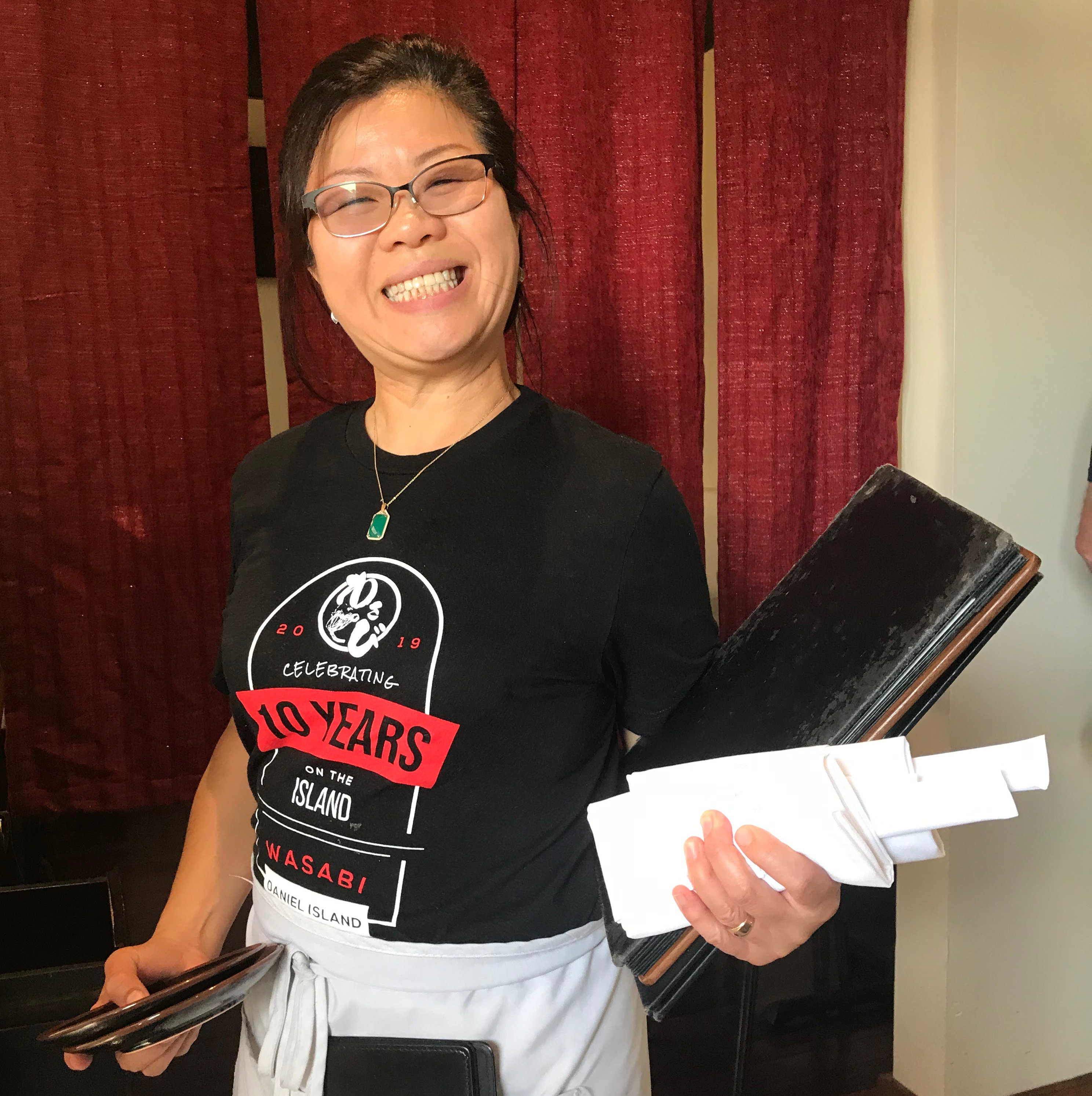 Wasabi waitress Vana Tang is all smiles over the restaurant's 10th anniversary this month!