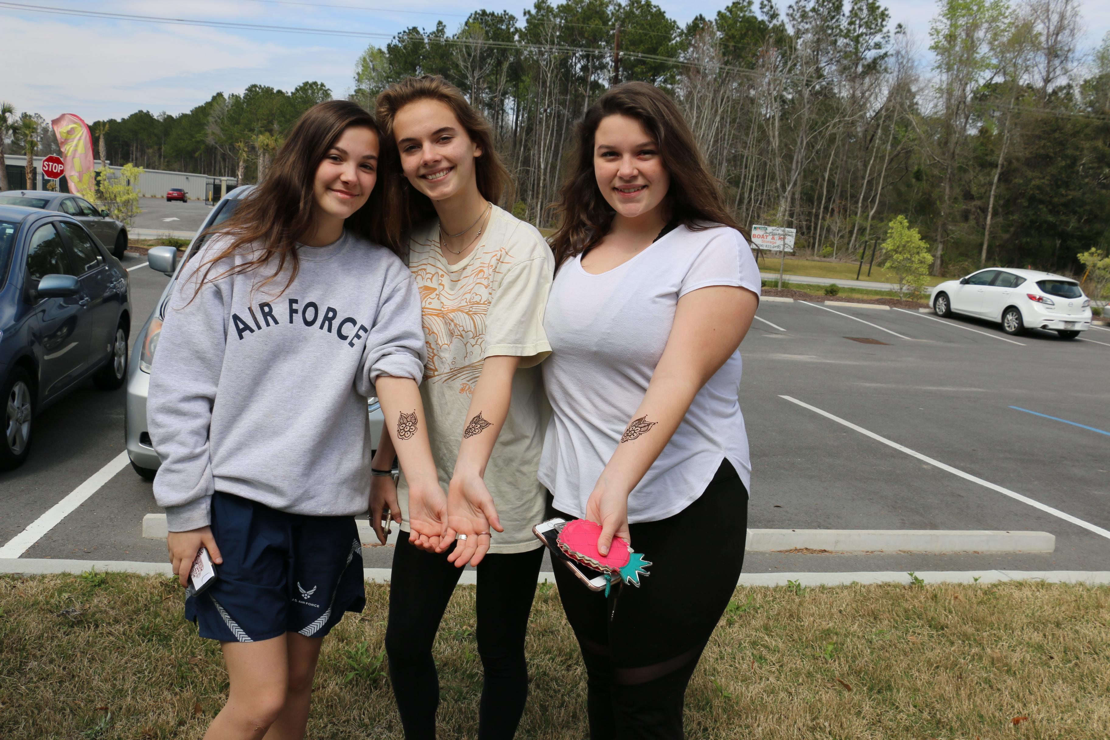 Jennifer Auckner, Hannah Floyd and Devyn Priest show off their henna tattoos by Nemali, LLC.