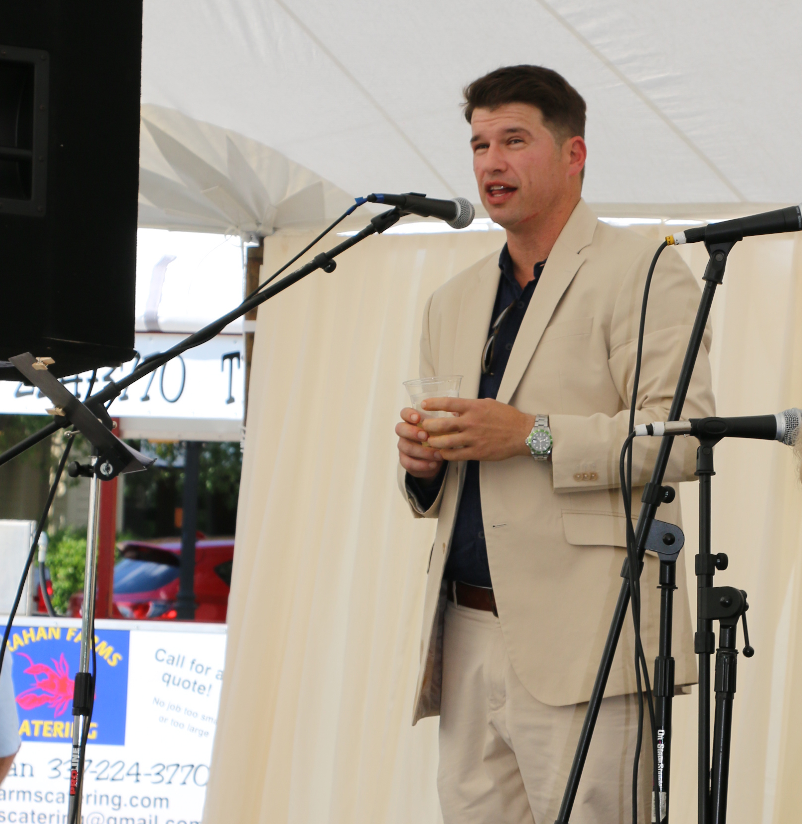 Phillip Manchester, a partner with S.L. Shaw & Associates – the company developing 297 Seven Farms Drive - addresses a crowd of commercial realtors, local business owners, and friends at a party held on site to announce and explain the project.
