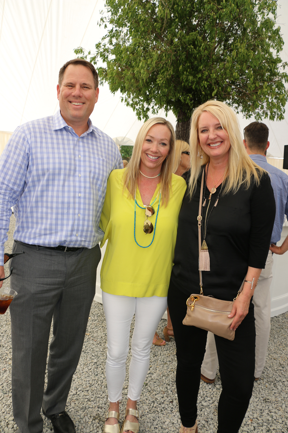 Commercial realtor Mark Erickson, interior decorator Hollis Erickson and Momentum Marketing principal Pam Hartley catch up at the party.