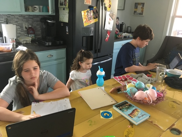 """The Hughes kids — from left, fifth-grader Haven, 2-year-old Poppy, and seventh-grader Rentz — are e-learning. Their mother, Alicia, asks, """"Can't you just see the joy and excitement in their eyes?"""""""