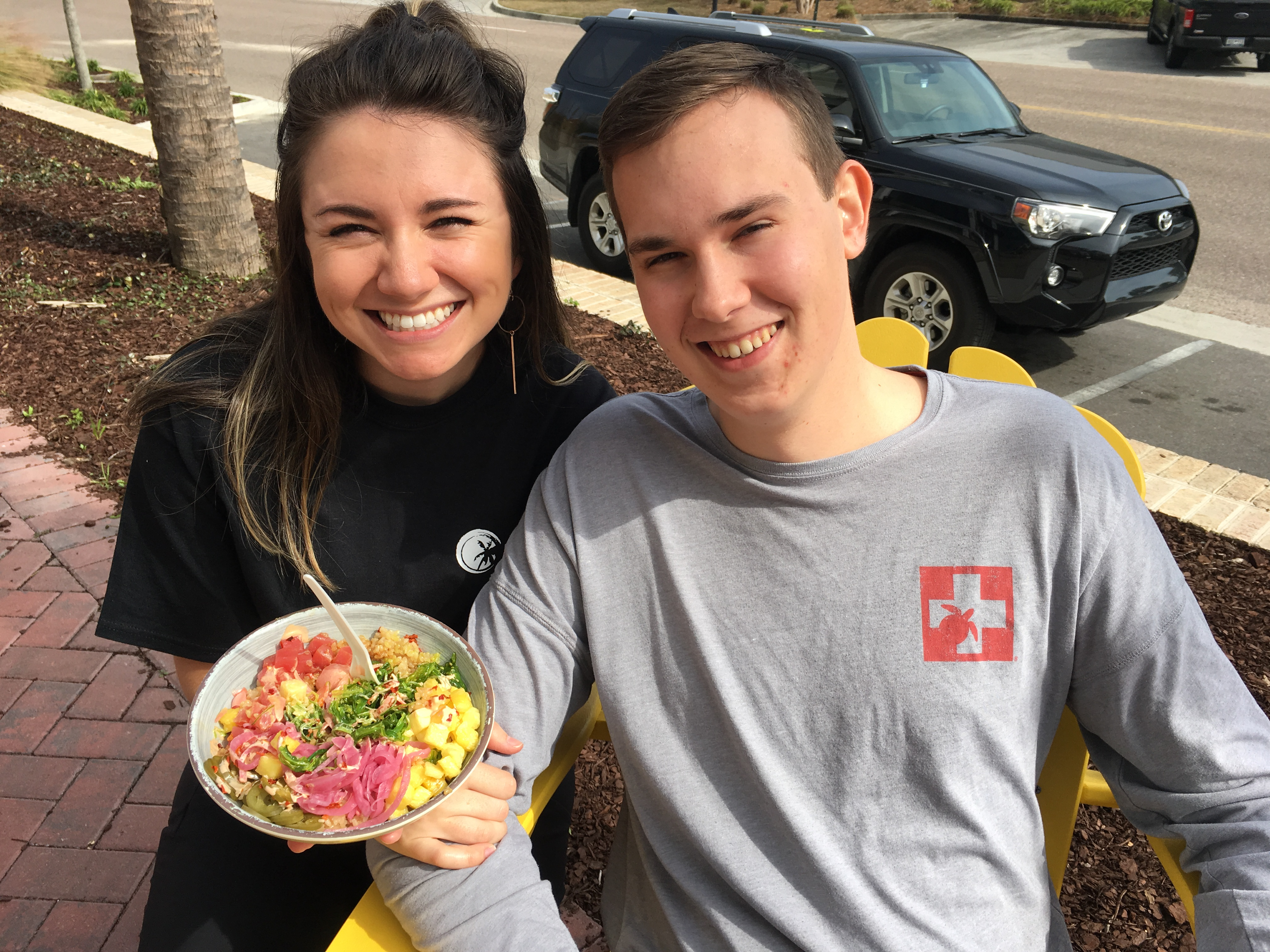 Victoria Futrell, who handles marketing for BEECH at both of their locations, enjoyed taking part in the Daniel Island store's grand opening fun last Saturday. She is pictured here with fellow attendee, Andrew Bock.