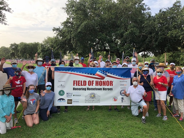 Exchange Club volunteers installed 650 flags at the Field of Honor on River Landing Drive on Saturday, June 27.