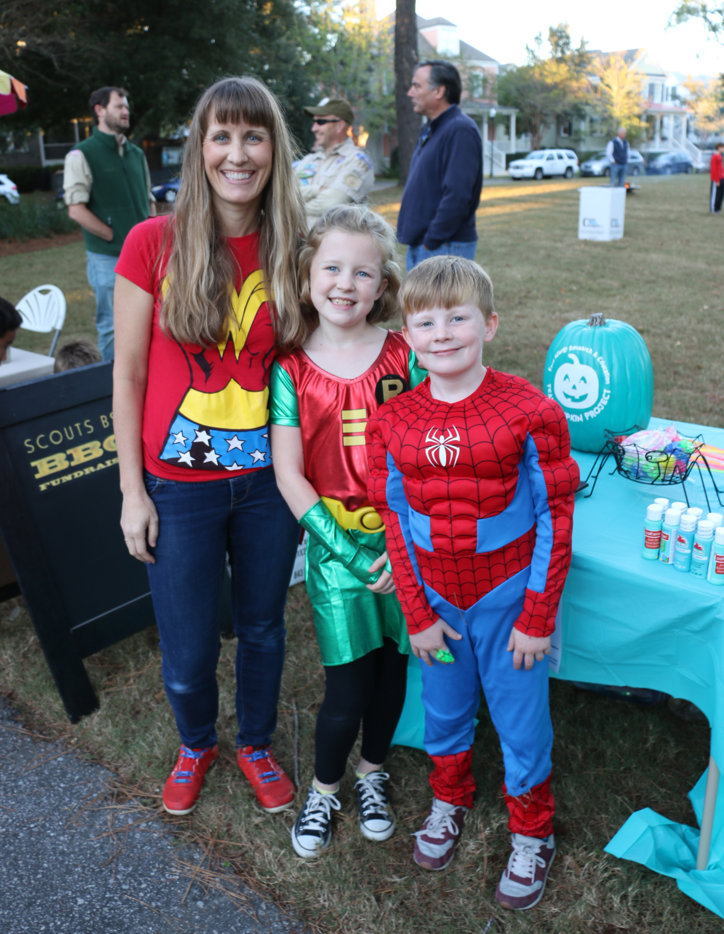 Daniel Island resident Cathy Leeke and her children, Meredith and Grayson, happily spread the word about the Teal Pumpkin Project at the event.
