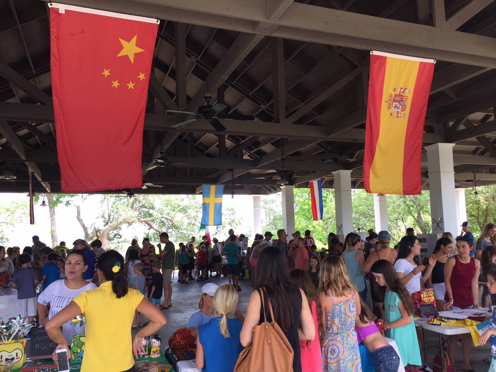 "A colorful crowd at Saturday's ""Around the World in 80 Minutes"" held at Pierce Park Pavilion."