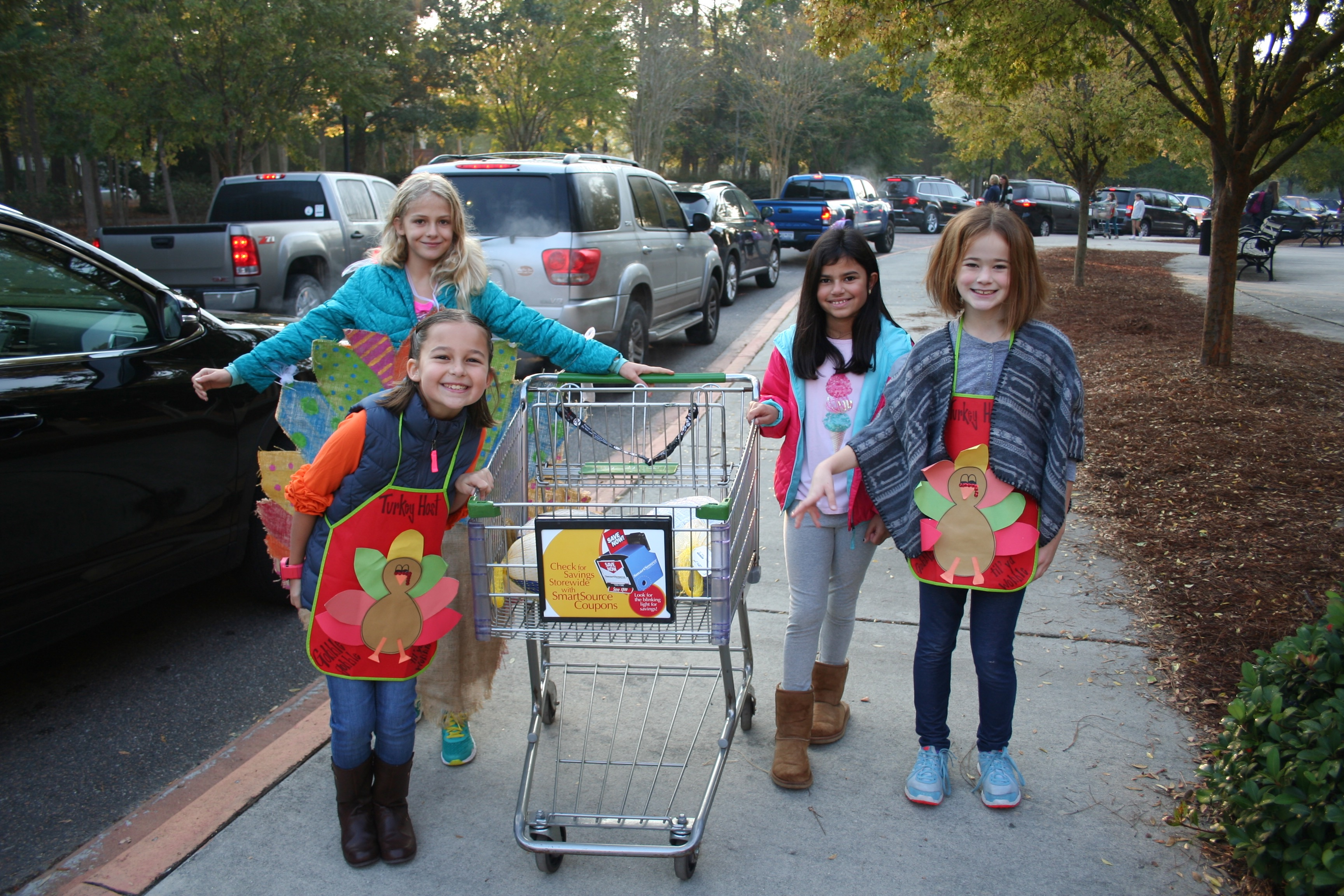 Talkin' turkey! Members of the DIS Community Crusaders Club were all smiles during their recent Frozen Turkey Drive at the school. Pictured left to right (clockwise) are Emma Ladd, Gracie Graue, Caroline D'Aguiar, and Charlotte Praete.