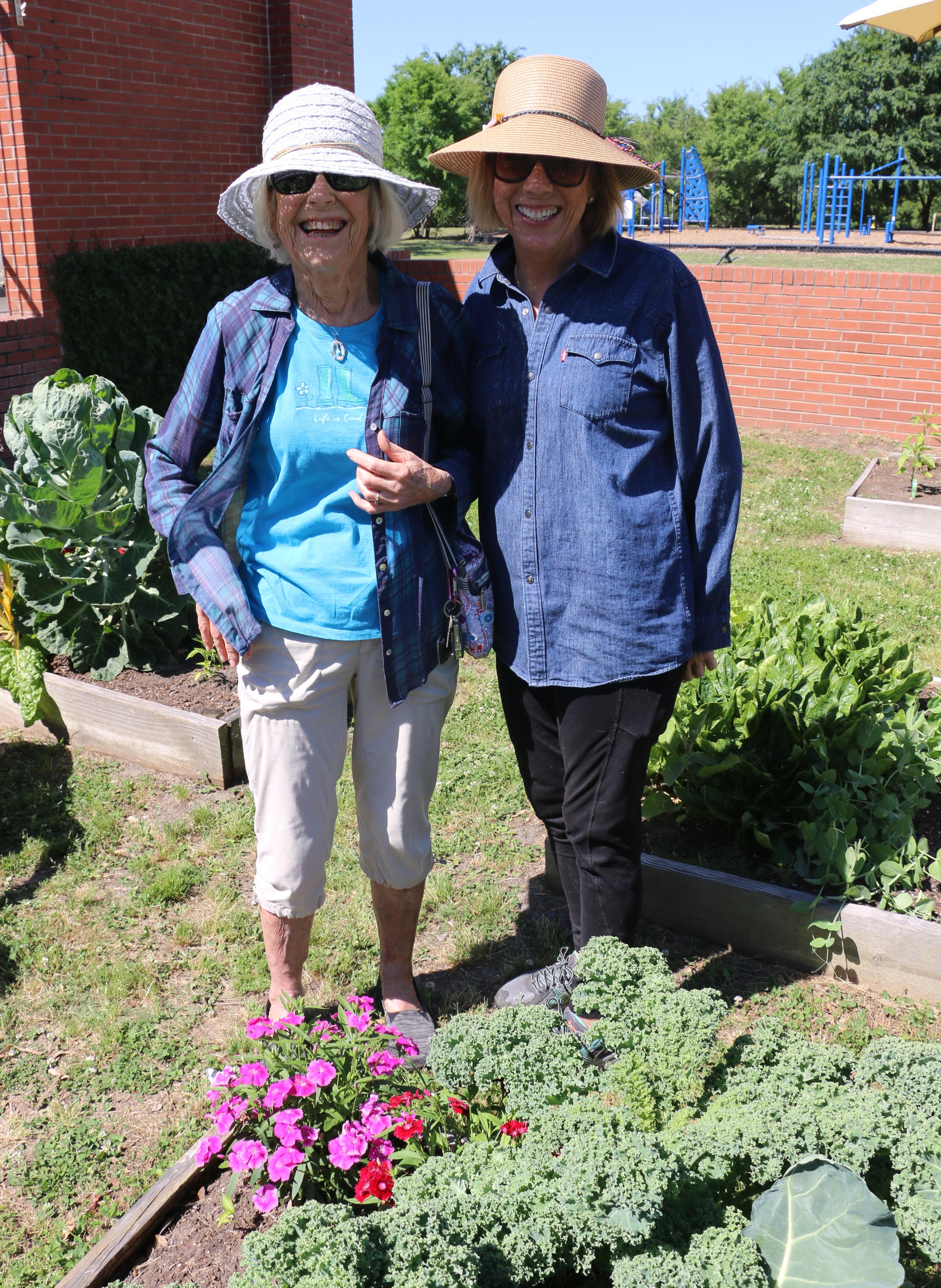Marion Franks, who tends a plot in the garden, is joined by volunteer Mary Wickmire.