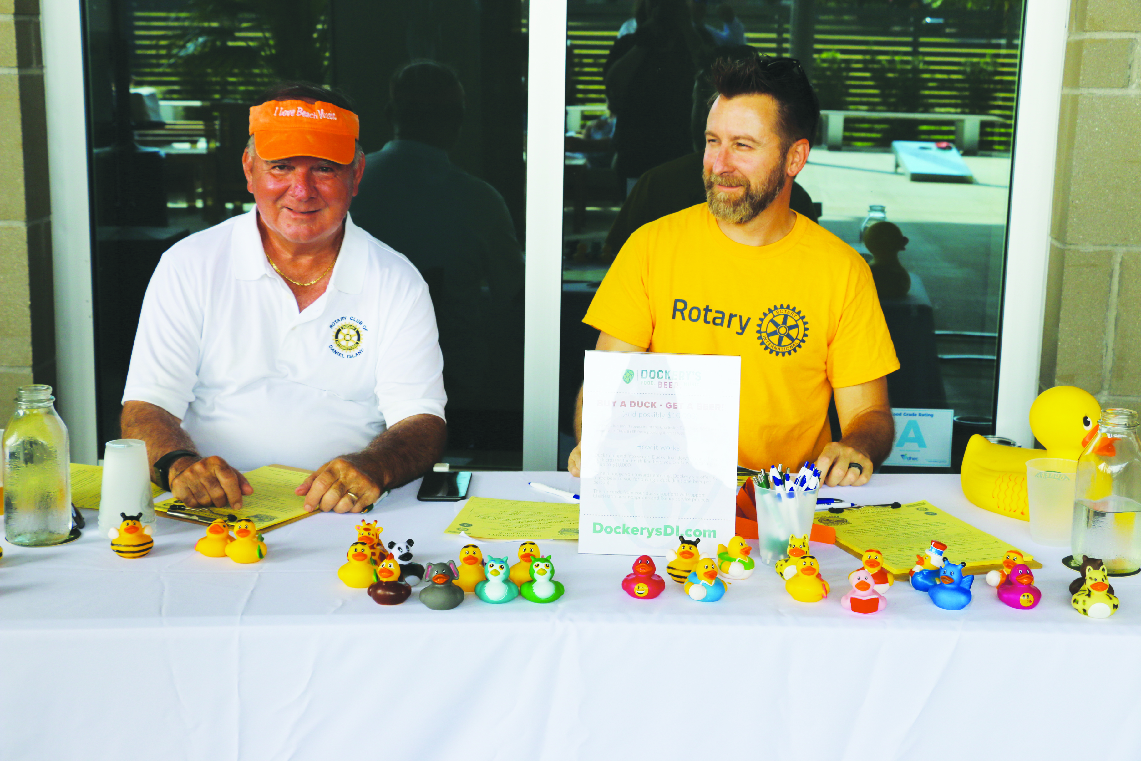 The sign-up table was filled with colorful ducks available for purchase.