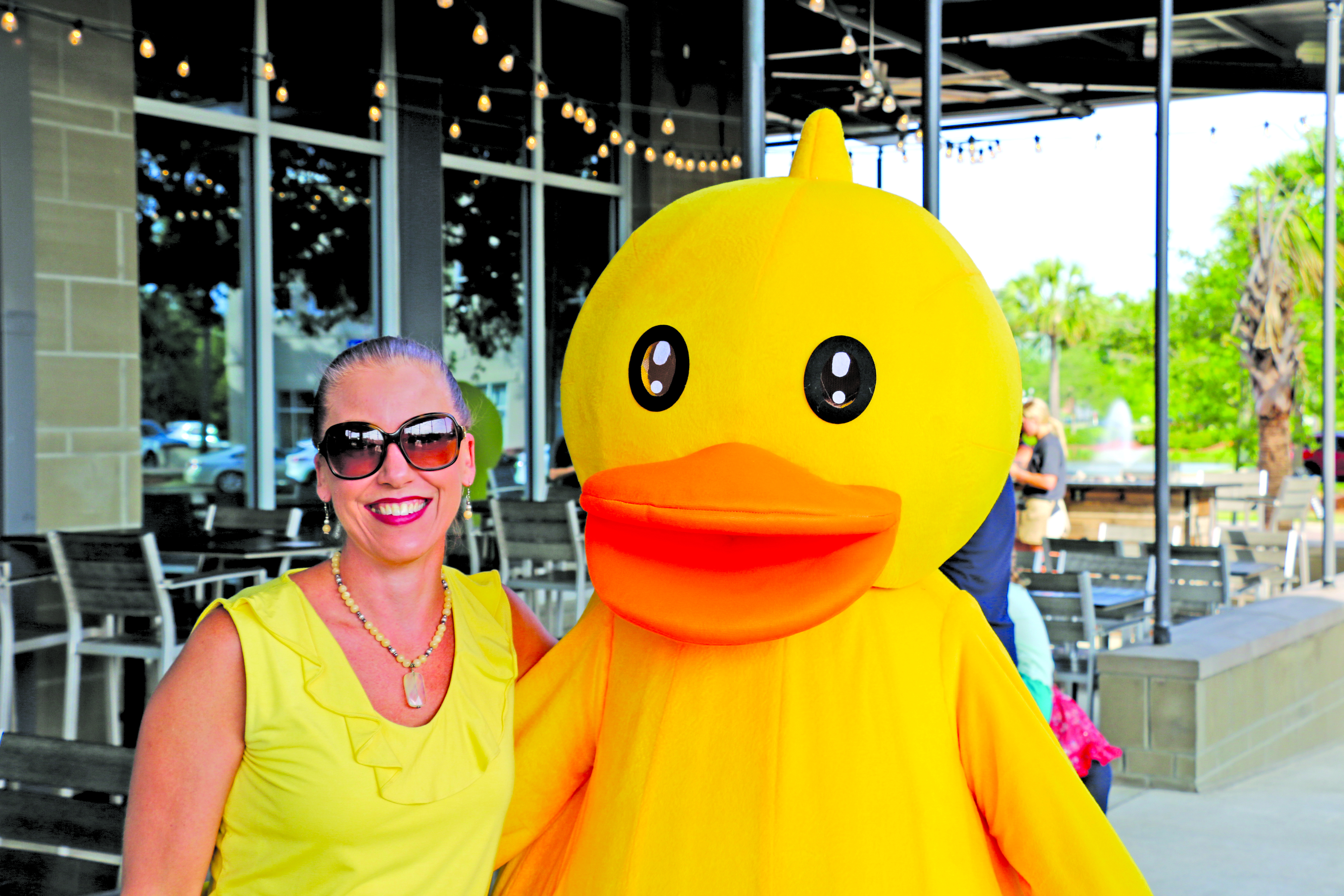 Heather Platzer stands with her husband, James,who is dressed in the duck costume.