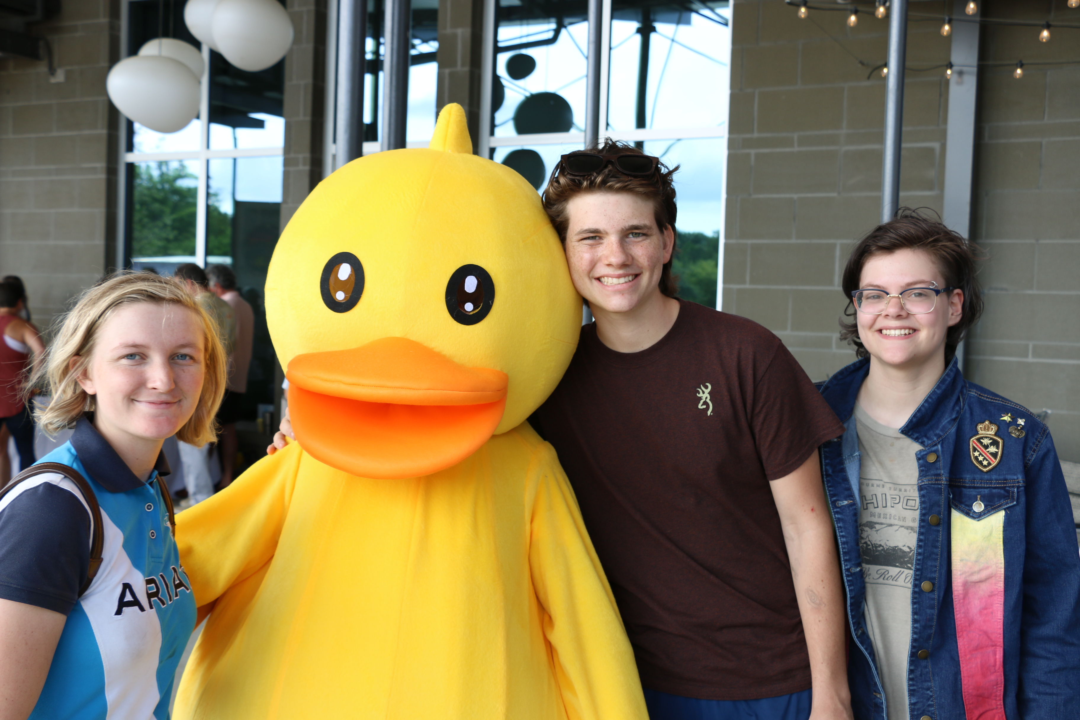 Daniel Island residents Jane Garvey, Ian Jacobs, and Sydney Hindman smile for a picture with the duck mascot.