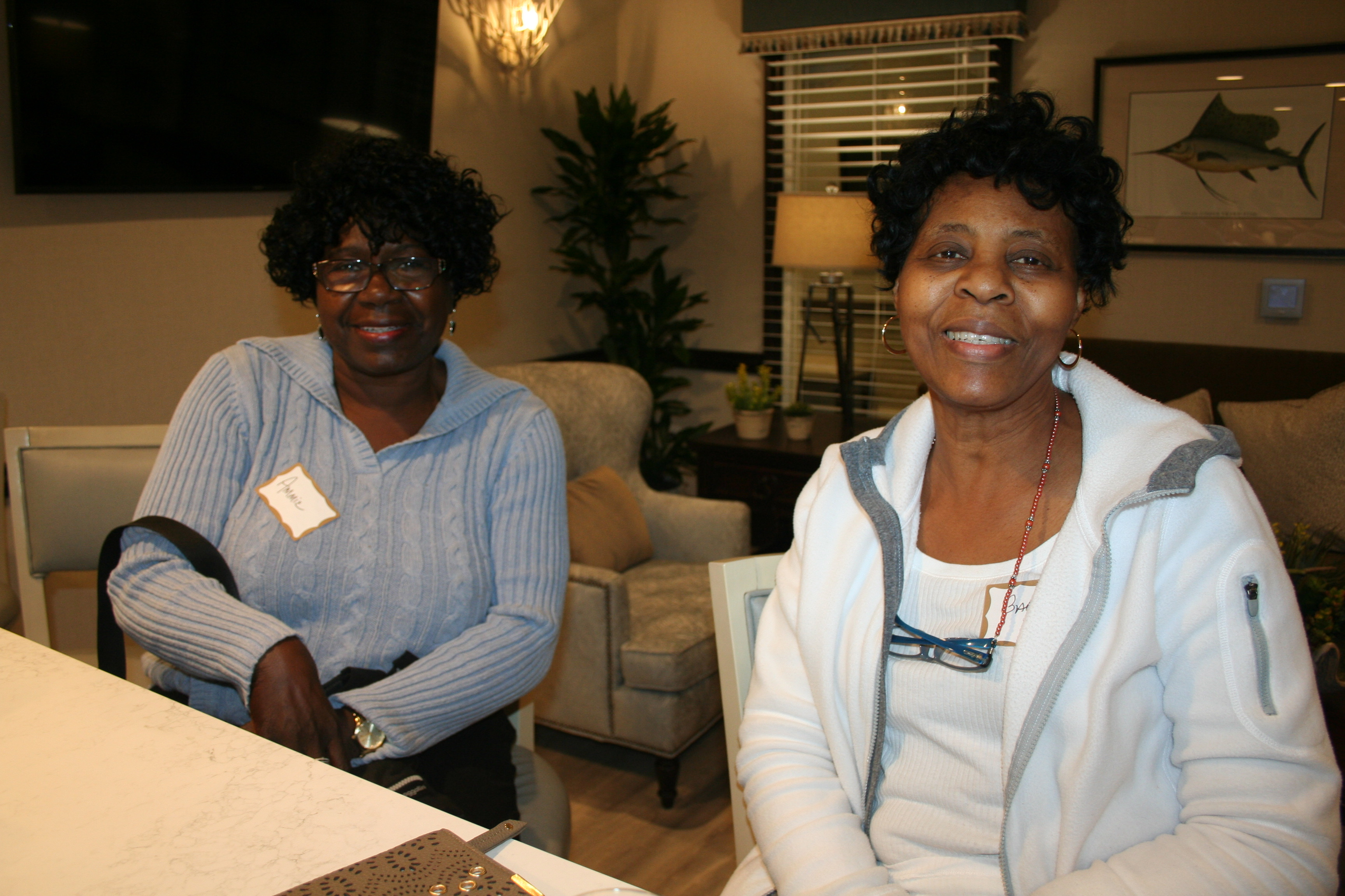 Ammie Lancaster of Charleston and Barbara Parrott of Mount Pleasant enjoyed refreshments in the center's dining room.