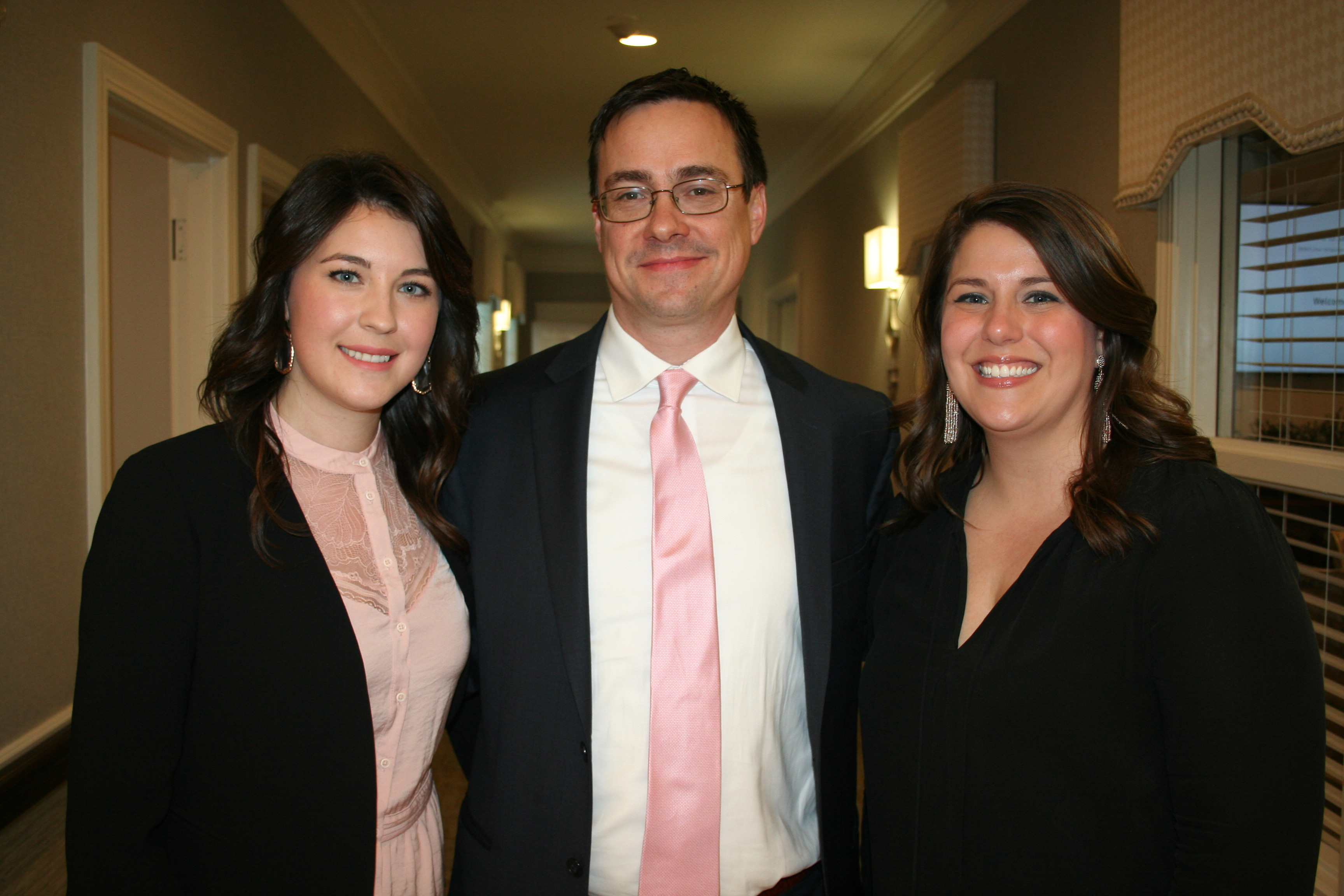 Wellmore Executive Director Ashley Seeds (left) poses with fellow staff members Jack Myers and Emilee Padget, who are both lifestyle advisors at the facility.