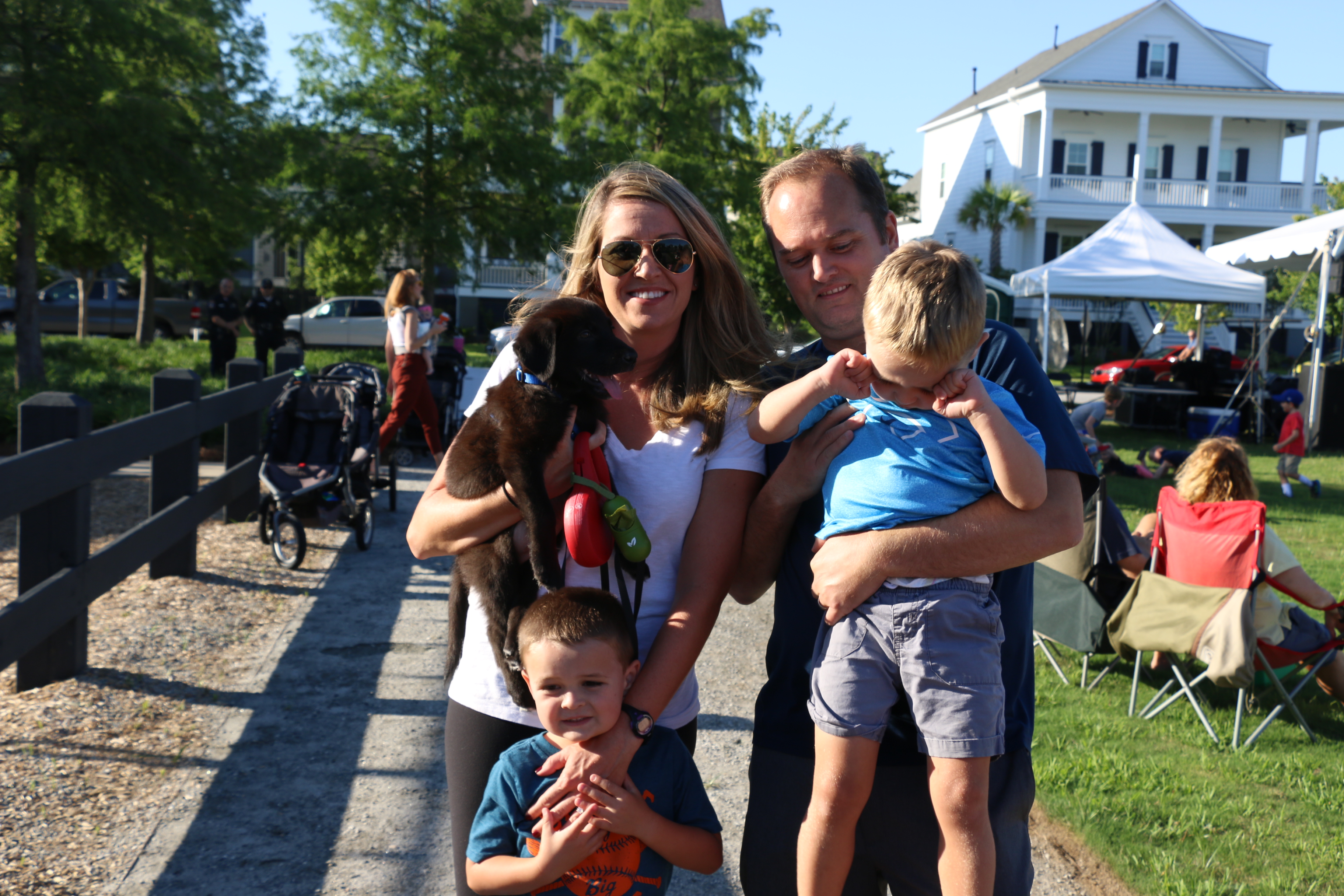 Kristin and Mike Bauer pose with their sons, Andrew and Luke, and puppy, Nash.
