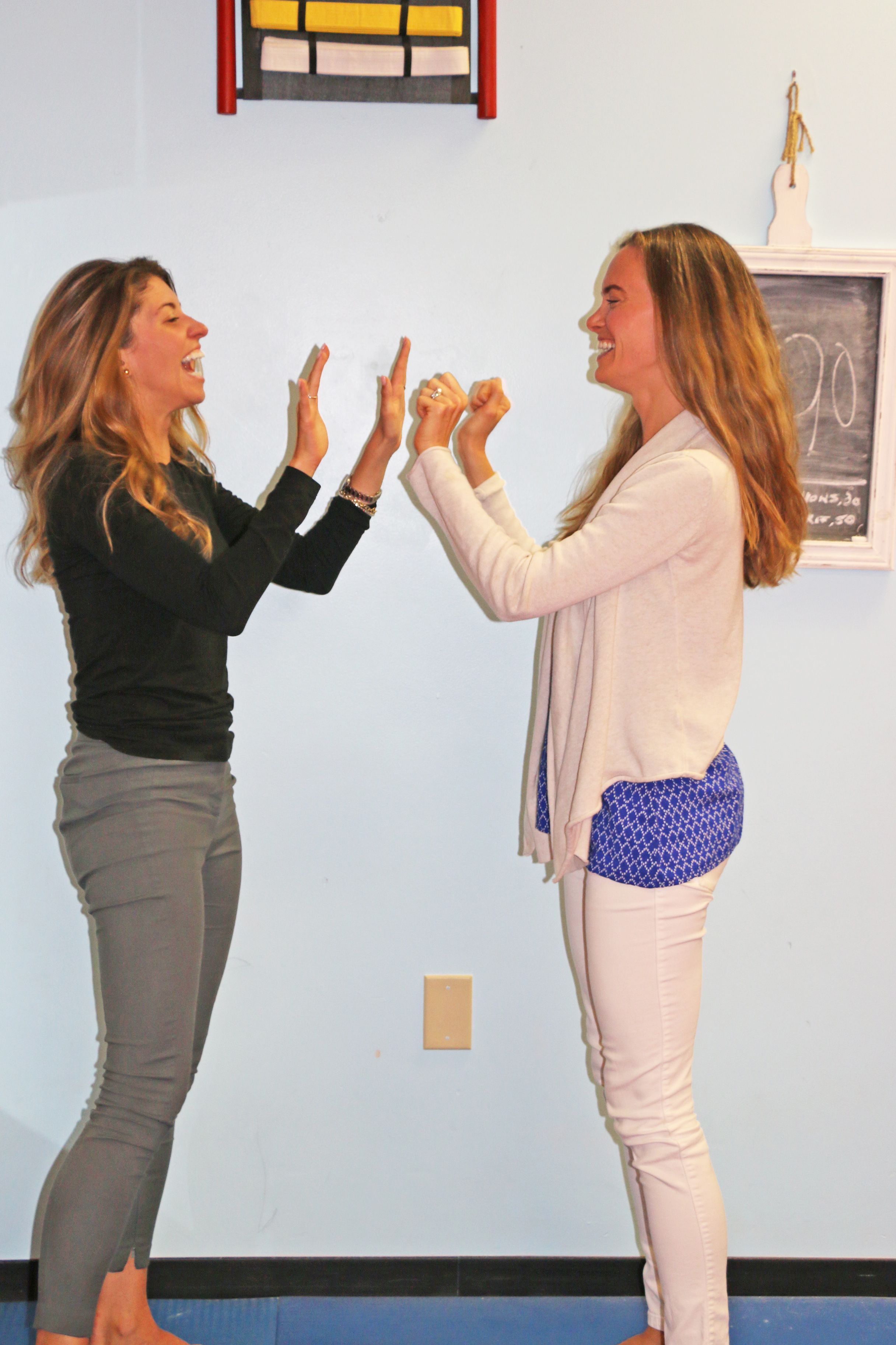 """Cristine Candland and Jill Miller practice throwing """"sharp knuckles,"""" an effective way to land multiple quick strikes on an attacker."""