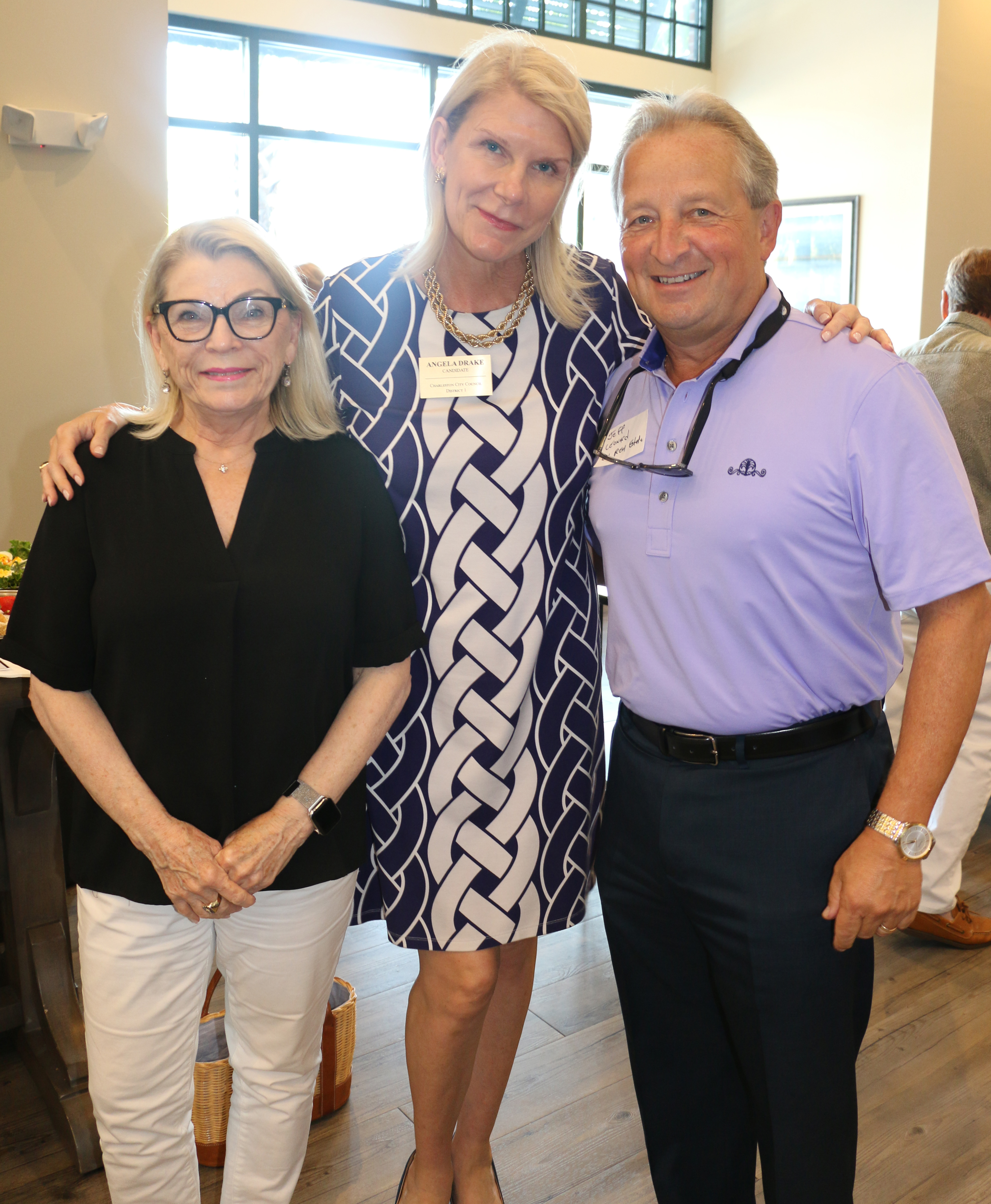 Daniel Island Real Estate agents Sally Castengera and Angela Drake visit with their broker, Jeff Leonard, as they enjoy food and festivities at the DIBA Block Party.