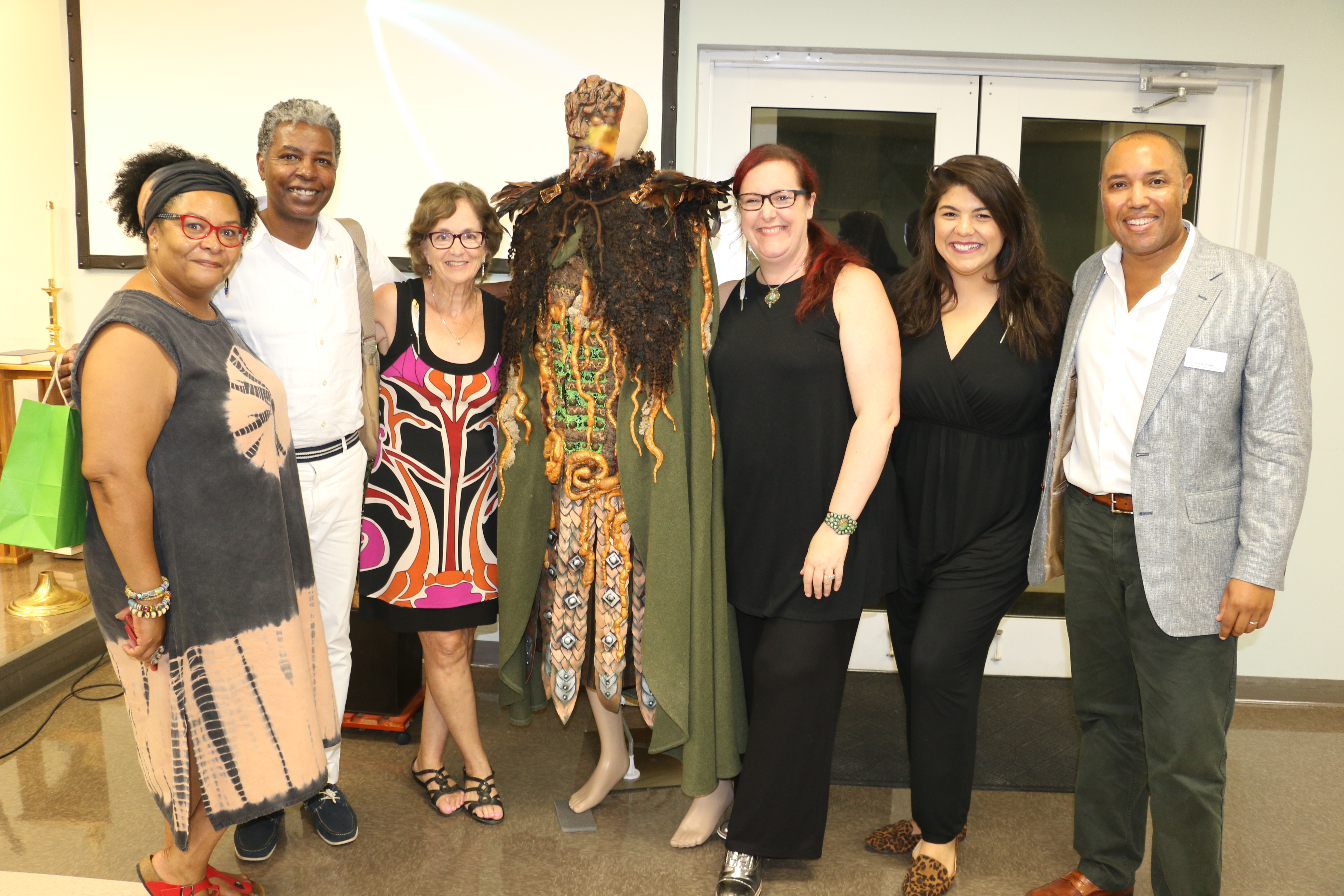 """Pictured left to right at the DIHS event are Joy Vandervort-Cobb, PURE Theatre; Jonathan Green; Carol Antman; the """"narrator"""" from Kris Manning's tree-inspired art installation for """"Osceola's Muse""""; Kris Manning; Camille Hayes, the play's co-director; and Chris Frisby, president of the Daniel Island Historical Society."""