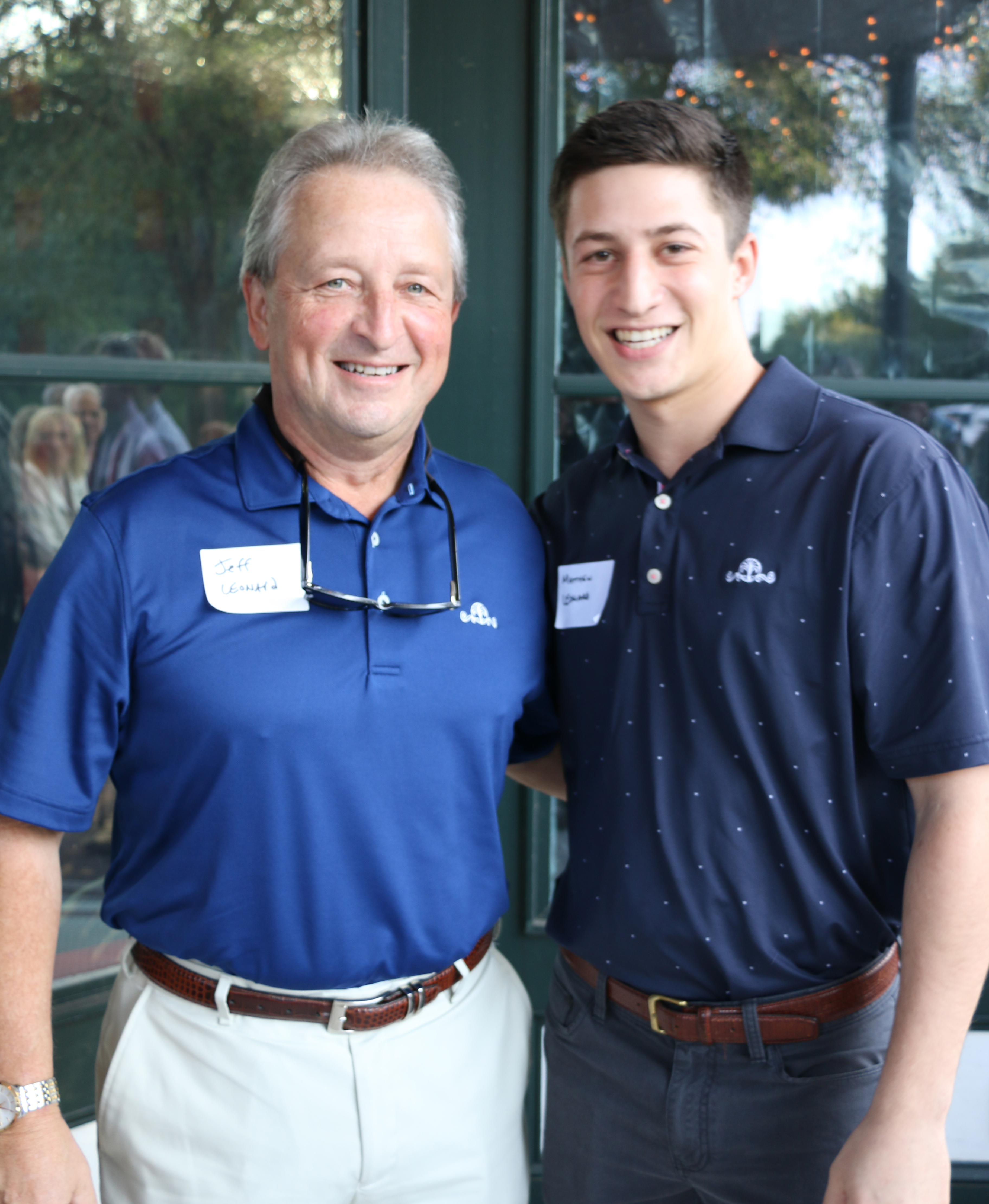 Daniel Island Real Estate VP of Sales and broker-in-charge Jeff Leonard, left, introduced his son Matthew to the many attendees at the DIBA October Block Party at LIDI.